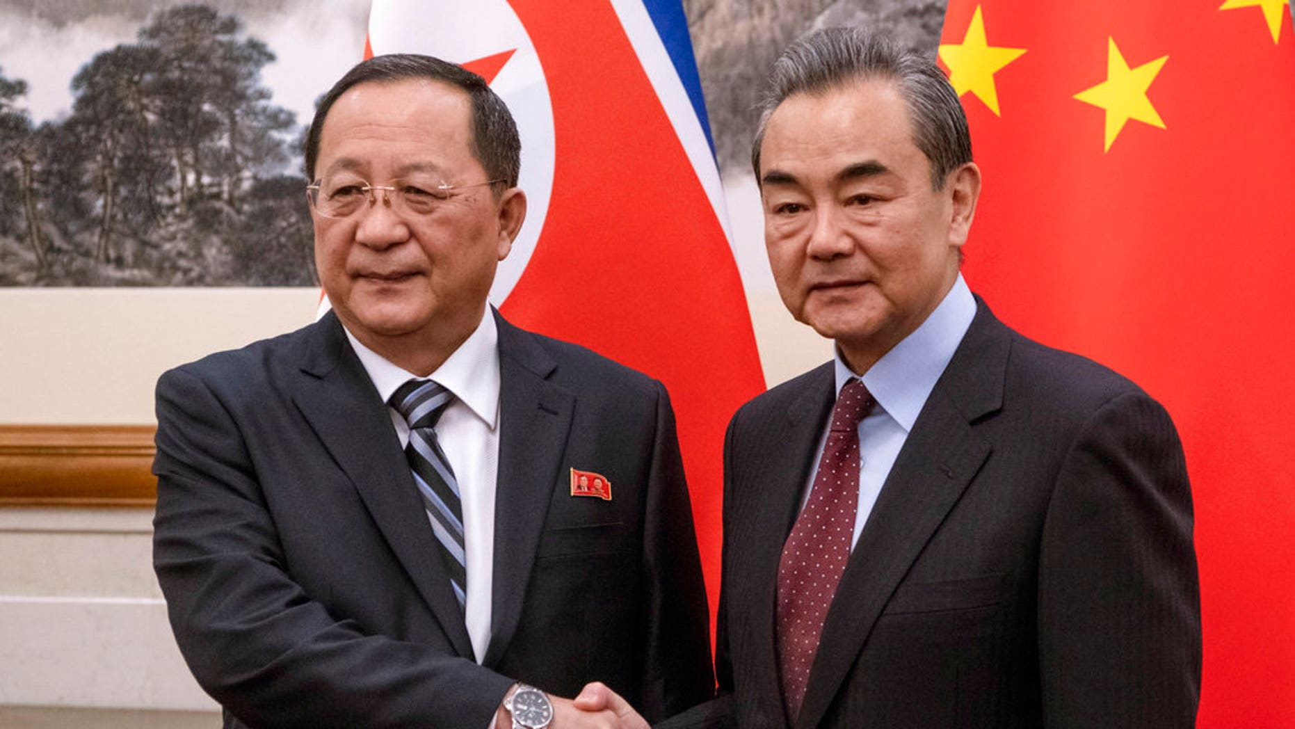North Korean Foreign Minister Ri Yong Ho, left meets China's Foreign Minister Wang Yi at the Diaoyutai State Guesthouse in Beijing.