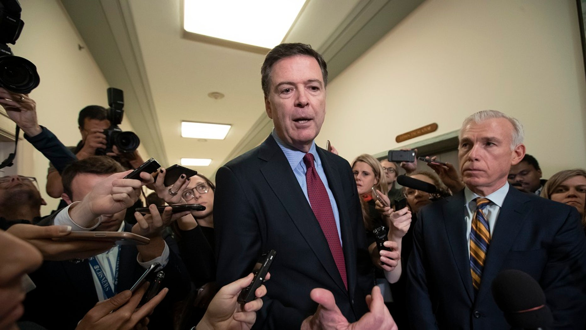 Former FBI Director James Comey, with his attorney, David Kelley, right, speaks to reporters after a day of testimony before the House Judiciary and Oversight committees, on Capitol Hill in Washington, Dec. 7, 2018. (Associated Press)
