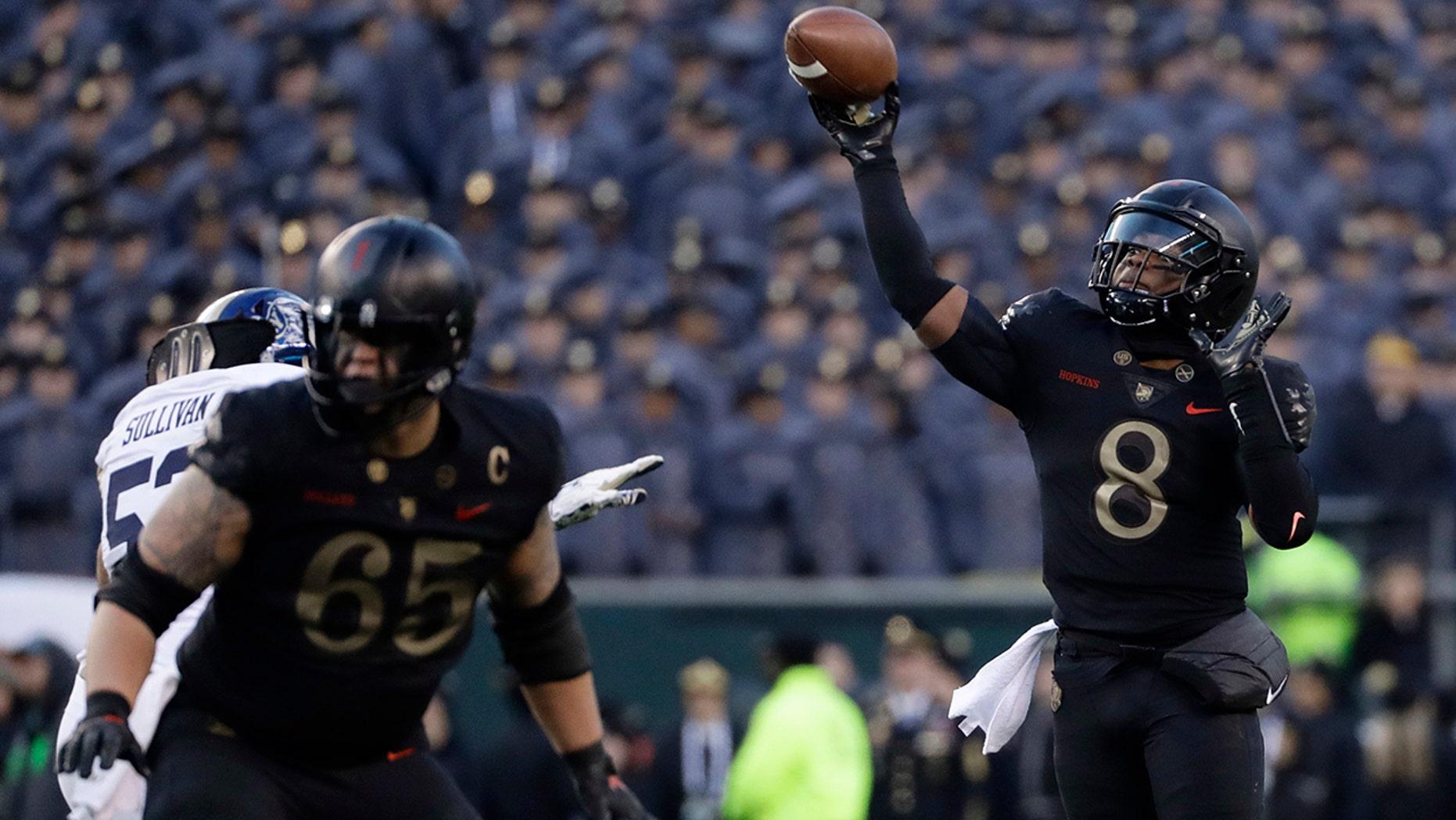 Army's Kelvin Hopkins Jr. throws a pass during the first half of an NCAA college football game against Navy, Saturday, Dec. 8, 2018, in Philadelphia. (AP Photo/Matt Slocum)