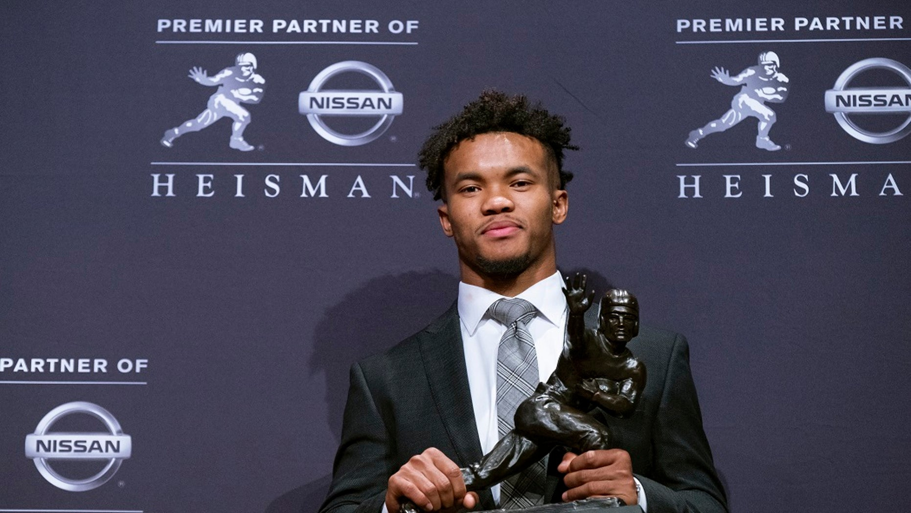 Oklahoma quarterback Kyler Murray holds the Heisman Trophy after winning the award Saturday, Dec. 8, 2018, in New York. (Associated Press)