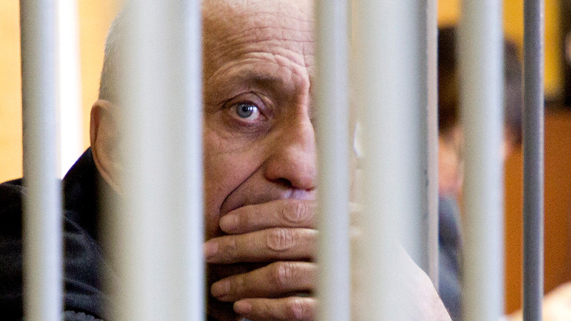 A court in Russia's eastern Siberia convicted Mikhail Popov, a former policeman of murdering 56 women, bringing the number he is believed to have killed to at least 78. (Julia Pykhalova, Komsomolskaya Pravda via AP)