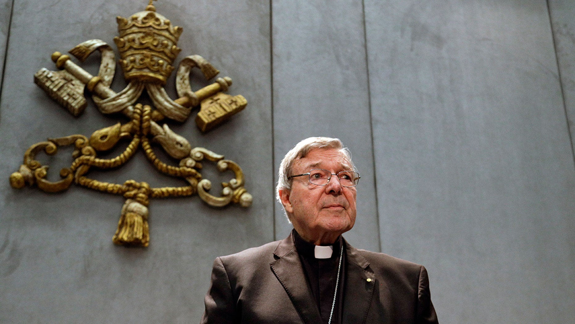 Cardinal George Pell was reportedly convicted in his native Australia of charges related to sexual abuse. The Vatican on Wednesday said he was removed from Pope Francis' informal cabinet.(AP Photo/Gregorio Borgia, File)