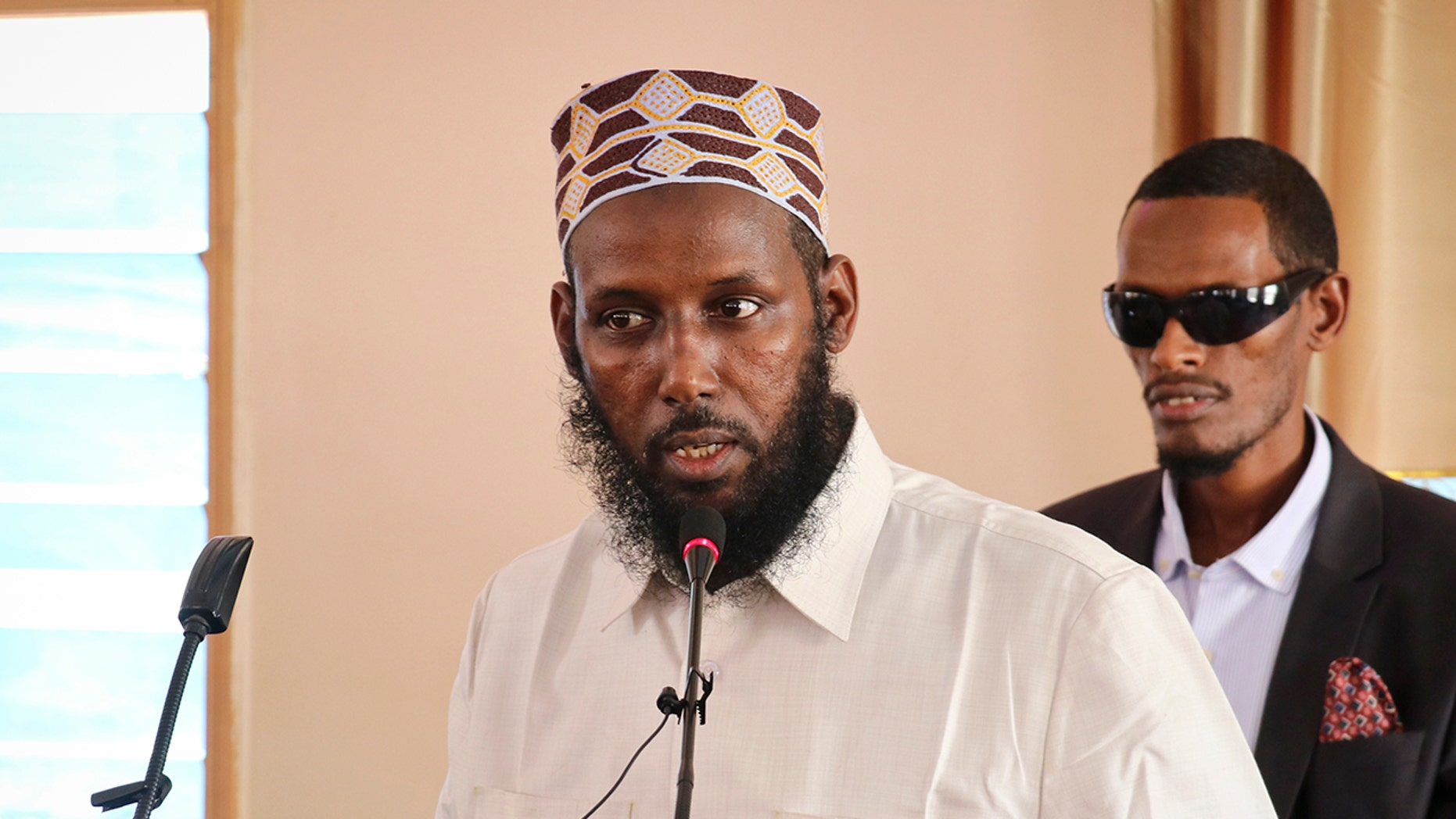 Mukhtar Robow, who was once deputy leader of Africa's deadliest Islamic extremist group the al-Qaida-linked al-Shabab, was arrested and beaten, sparking violent protests that left at least four dead. (AP Photo/File)