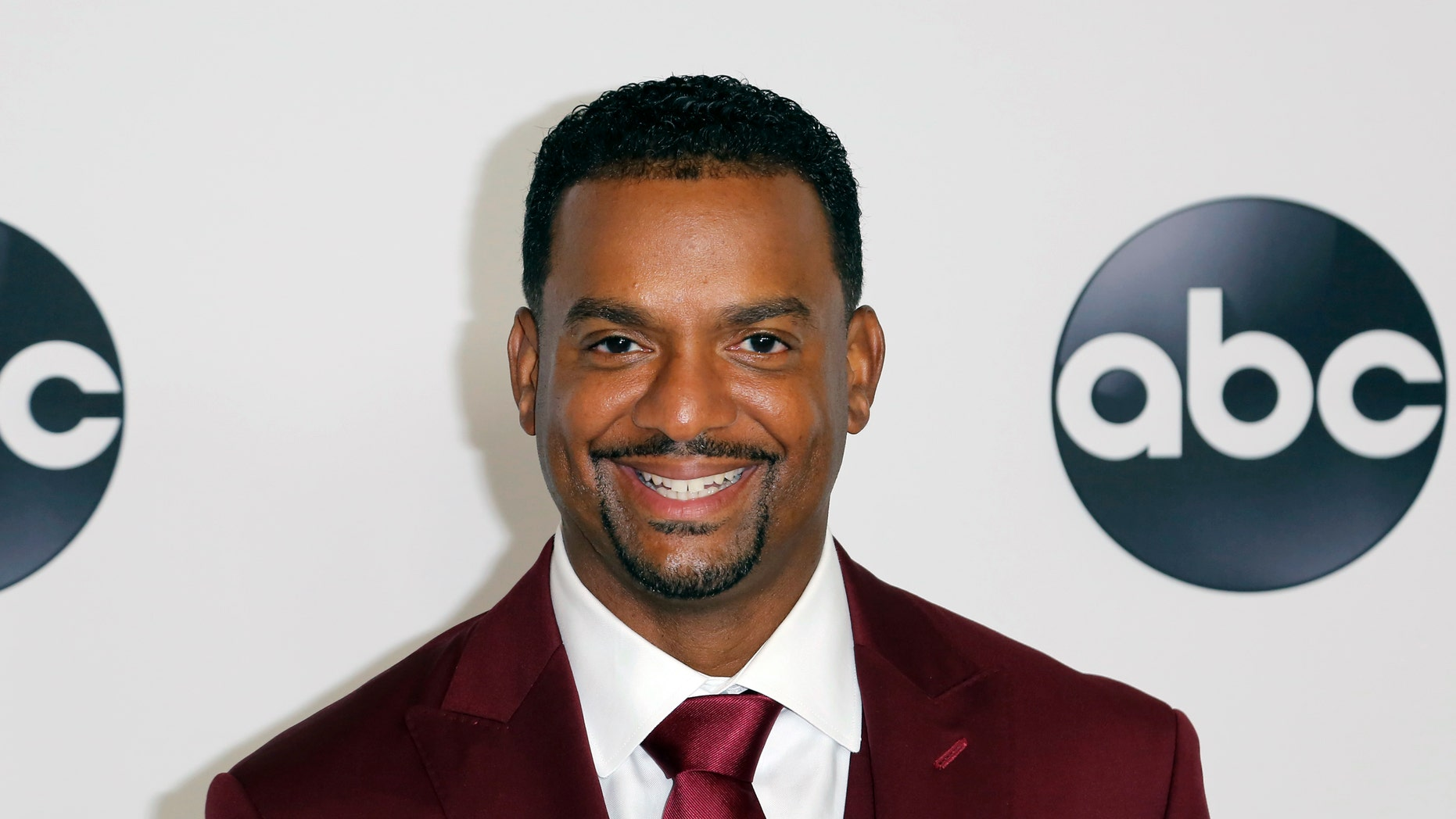 """FILE - In this Aug. 7, 2018 file photo, Alfonso Ribeiro arrives at the Disney/ABC 2018 Television Critics Association Summer Press Tour in Beverly Hills, Calif. Ribeiro is suing creators of Fortnite and NBA 2K for using his famous dance as Carlton from """"The Fresh Prince of Bel-Air"""" on the popular video games."""