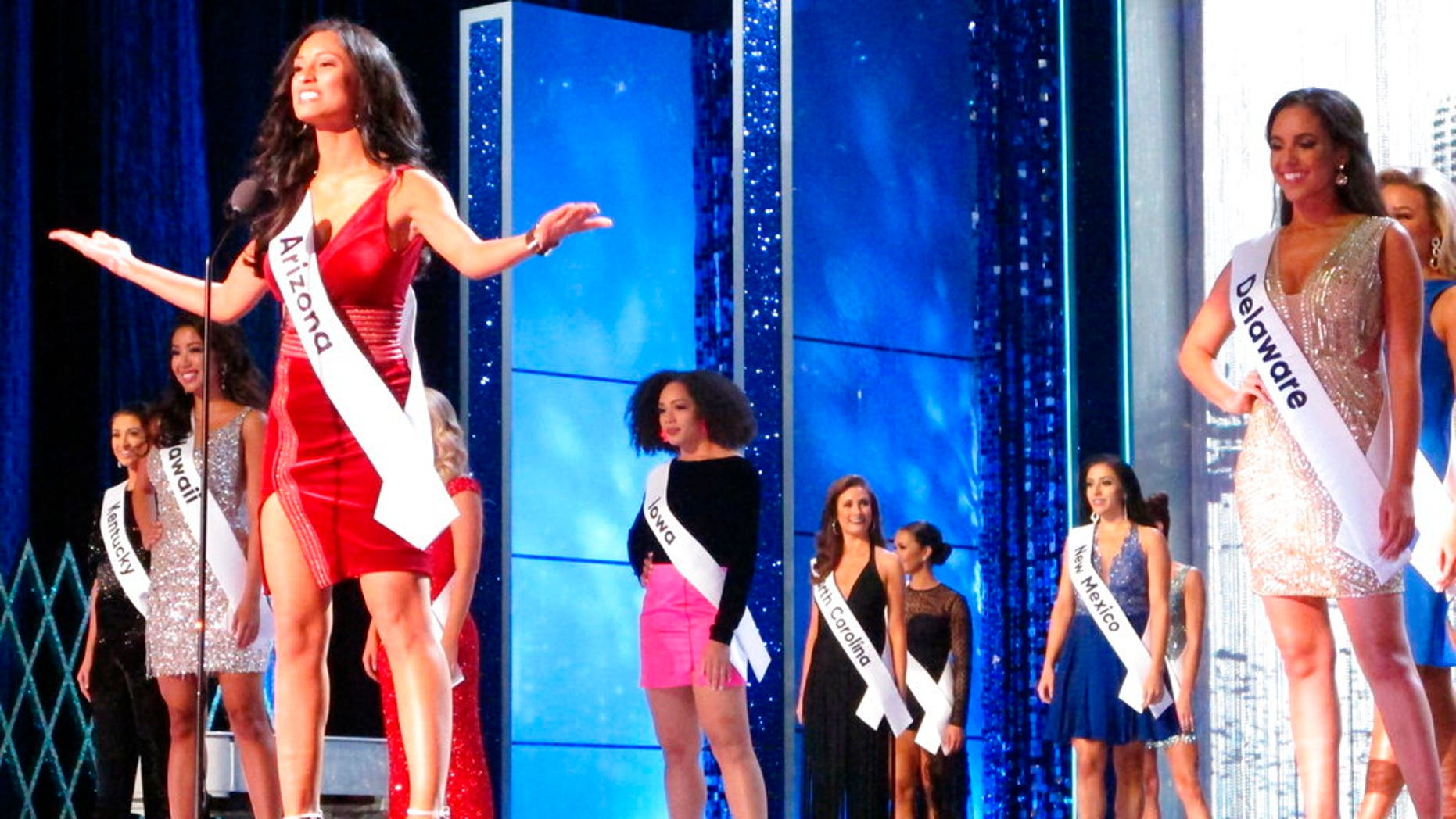 Miss Arizona Isabel Ticlo introduces herself at the start of the third and final night of preliminary competition at the Miss America competition in Atlantic City, N.J., earlier this year. (Associated Press)
