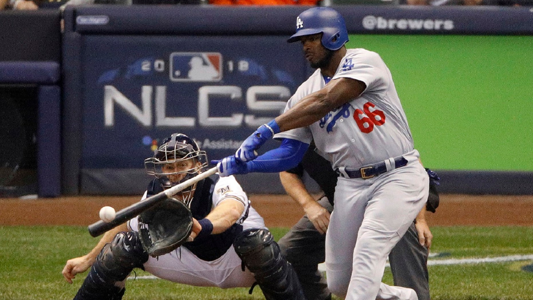 FILE: Los Angeles Dodgers' Yasiel Puig (66) hits a three -run home run during the sixth inning of Game 7 of the National League Championship Series baseball game against the Milwaukee Brewers in Milwaukee, Oct. 20, 2018.