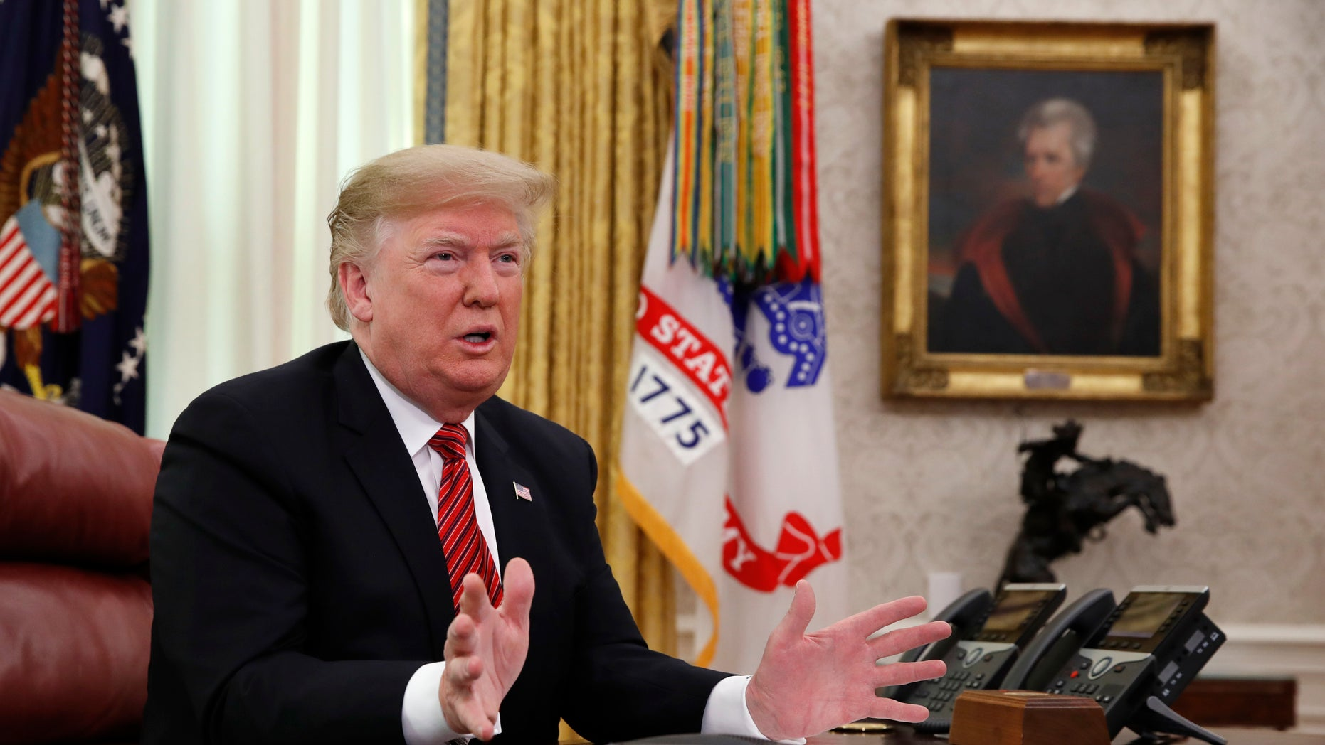 President Trump greets members of the five branches of the military by video conference on Christmas Day. (Associated Press)