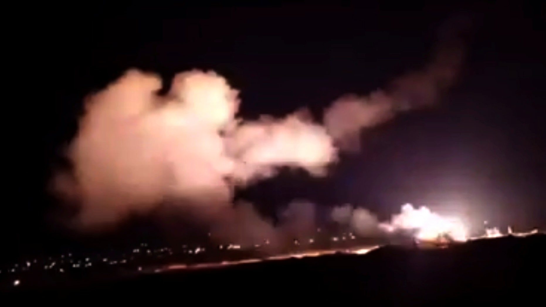 """This frame grab from a video provided by the Syrian official news agency SANA shows that rockets are flying into the sky near Damascus, Syria, Tuesday, December 25, 201<div class=""""e3lan e3lan-in-post1""""><script async src=""""//pagead2.googlesyndication.com/pagead/js/adsbygoogle.js""""></script> <!-- Text_Display_Ad --> <ins class=""""adsbygoogle""""      style=""""display:block""""      data-ad-client=""""ca-pub-7542518979287585""""      data-ad-slot=""""2196042218""""      data-ad-format=""""auto""""></ins> <script> (adsbygoogle = window.adsbygoogle    []).push({}); </script></div>8. Israeli fighters are flying over Lebanon and firing rockets Areas near the Syrian capital Damascus hit a weapons depot late Tuesday and wounded three soldiers, Syrian state media said most missiles were shot down by air defense units. (SANA via AP)"""