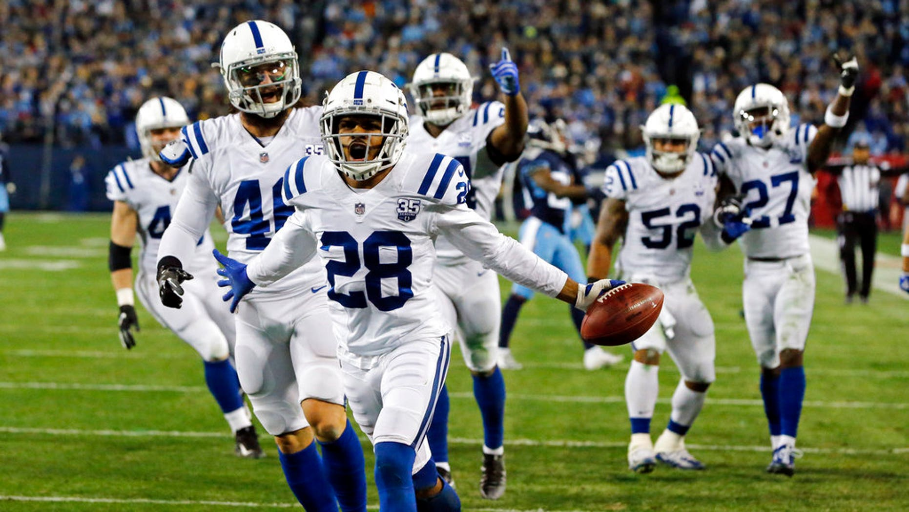 Indianapolis Colts cornerback Chris Milton (28) celebrates after recovering a punt fumbled by the Tennessee Titans in the first half of an NFL football game in Nashville, Tenn.