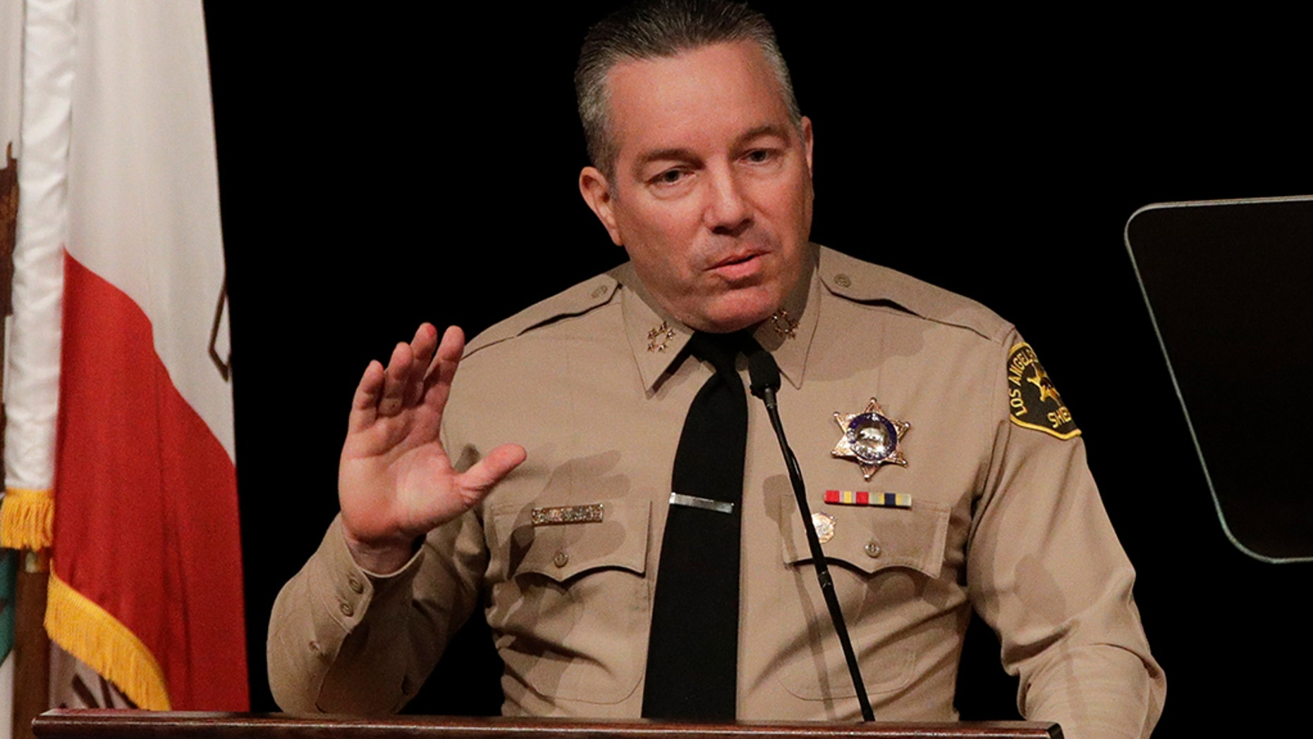 Newly elected Los Angeles County Sheriff Alex Villanueva during a swearing-in ceremony Monday, Dec. 3, in Monterey Park. (AP Photo/Jae C. Hong)