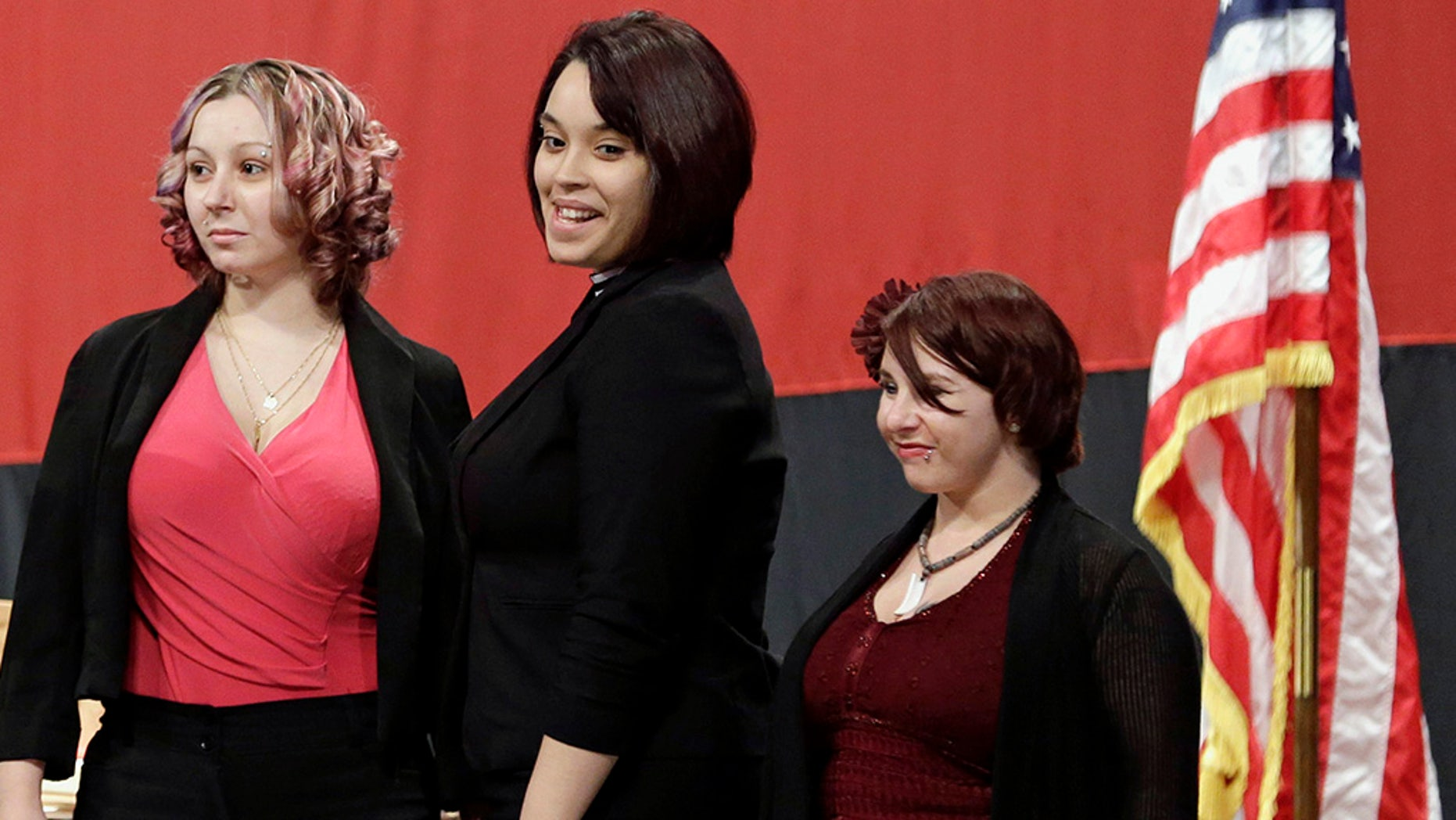 From left, Amanda Berry, Gina DeJesus, and Michelle Knight,who had been snatched off the streets separately between 2002 and 2004 and locked inside Ariel Castro's house where he chained and raped them, investigators later said. (AP Photo/Tony Dejak, File)