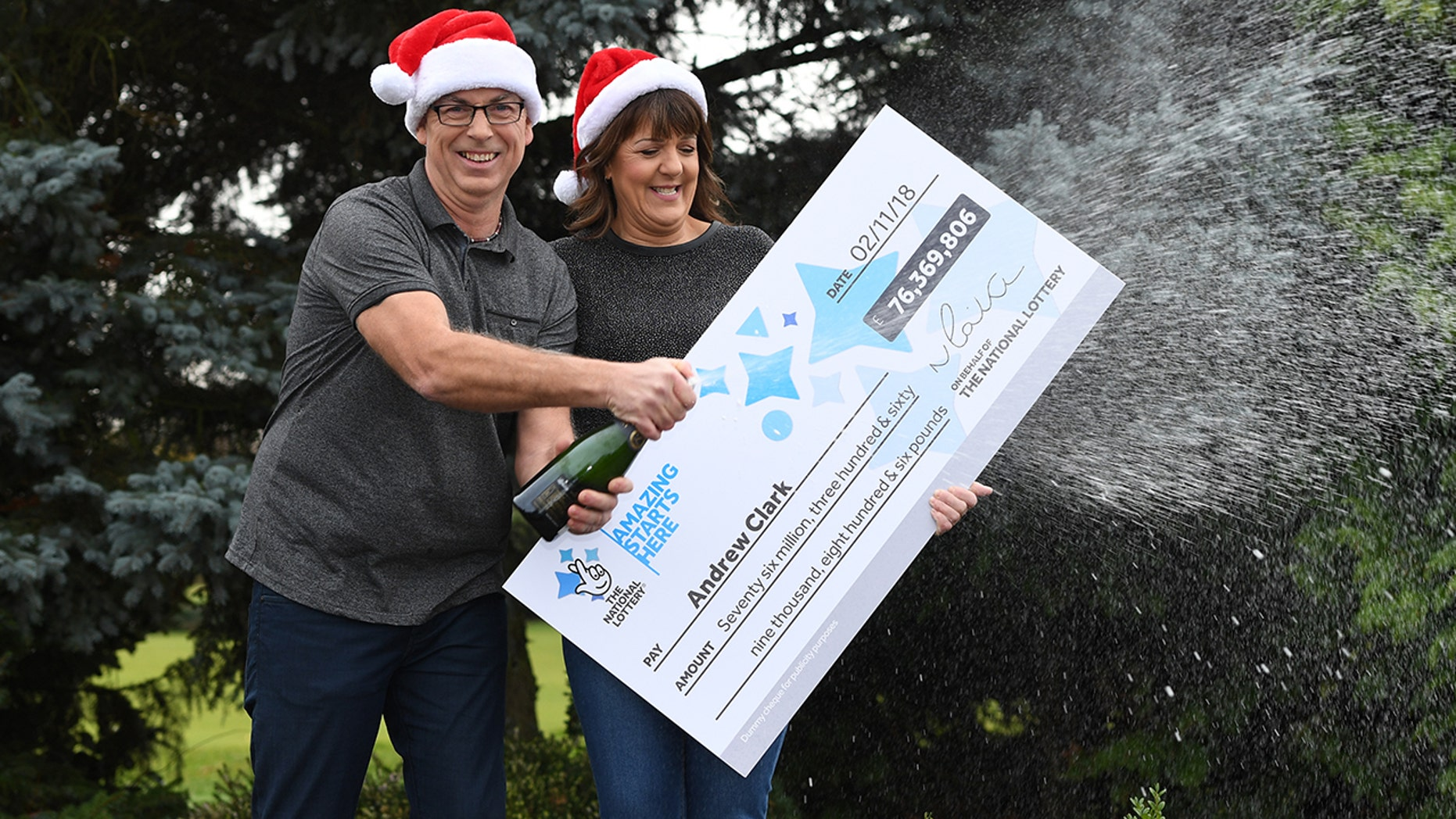 Andrew Clark, 51, from Boston, Lincolnshire, with his partner Trisha Fairhurst, celebrates his £76,369,806.80 EuroMillions jackpot win from the draw on Friday, Nov. 2, 2018, at Belton Woods Hotel, Grantham. (Getty Images)