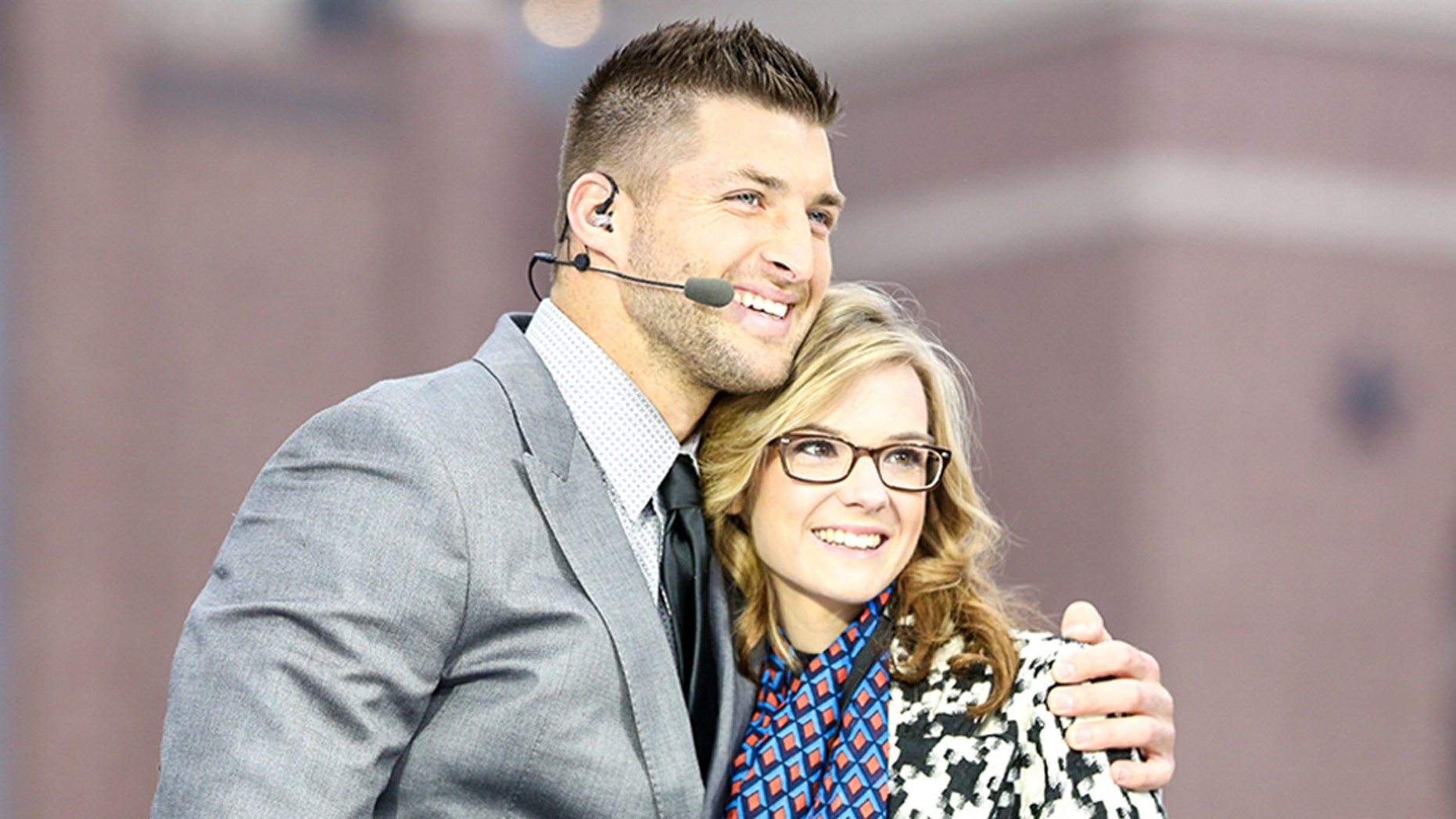 Tim Tebow and Chelsie Watts embraced during her weekend wish with the outspoke Christian athlete.