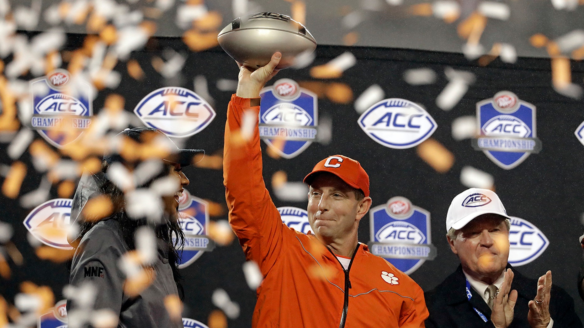 Clemson conduct manager Dabo Swinney raises a prize after Clemson won a Atlantic Coast Conference championship NCAA college football diversion opposite Pittsburgh in Charlotte, N.C., Saturday, Dec. 1, 2018. (AP Photo/Chuck Burton)