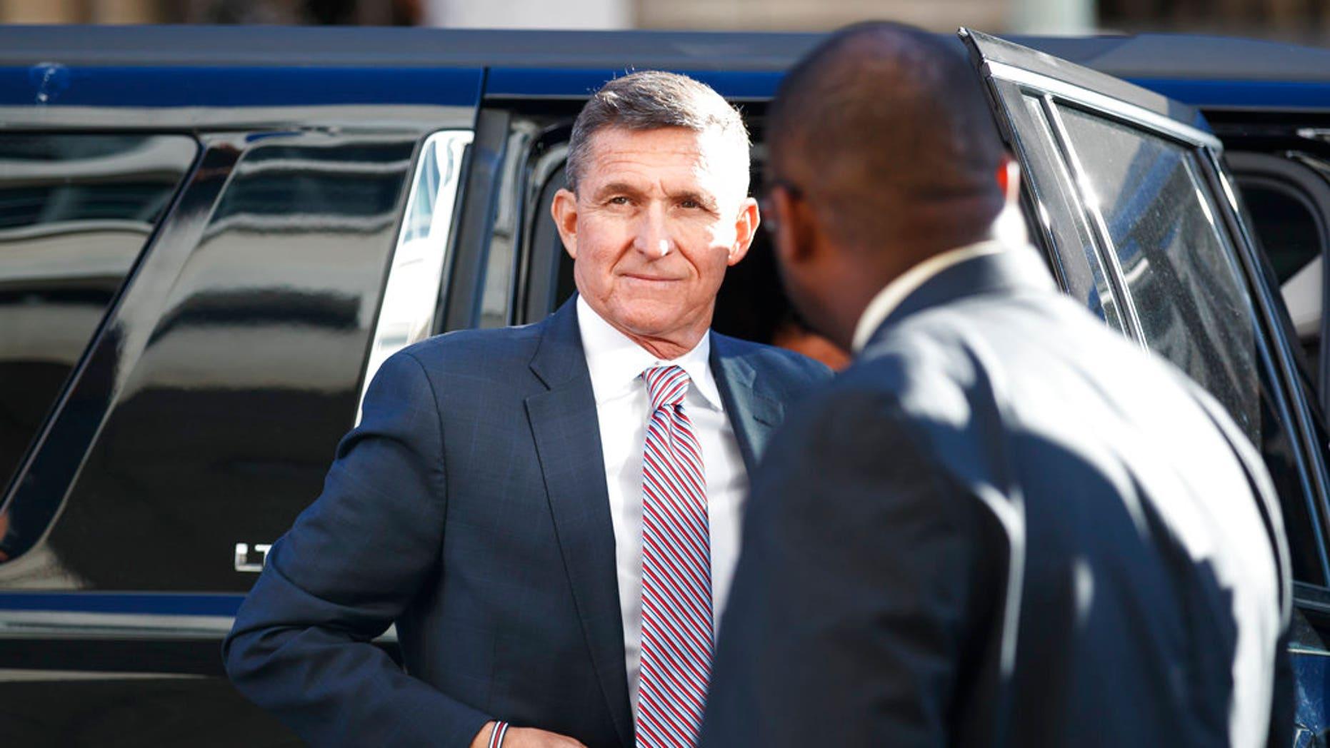 President Donald Trump's former National Security Advisor Michael Flynn arrives at federal court in Washington, Tuesday, Dec. 18, 2018. (AP Photo/Carolyn Kaster)