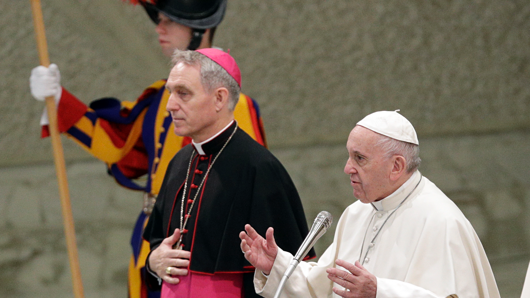Pope Francis flanked by Monsignor Georg Gaenswein blesses the faithful on the occasion of the weekly general audience, at the Vatican, Wednesday, Dec. 19, 2018. (AP Photo/Gregorio Borgia)