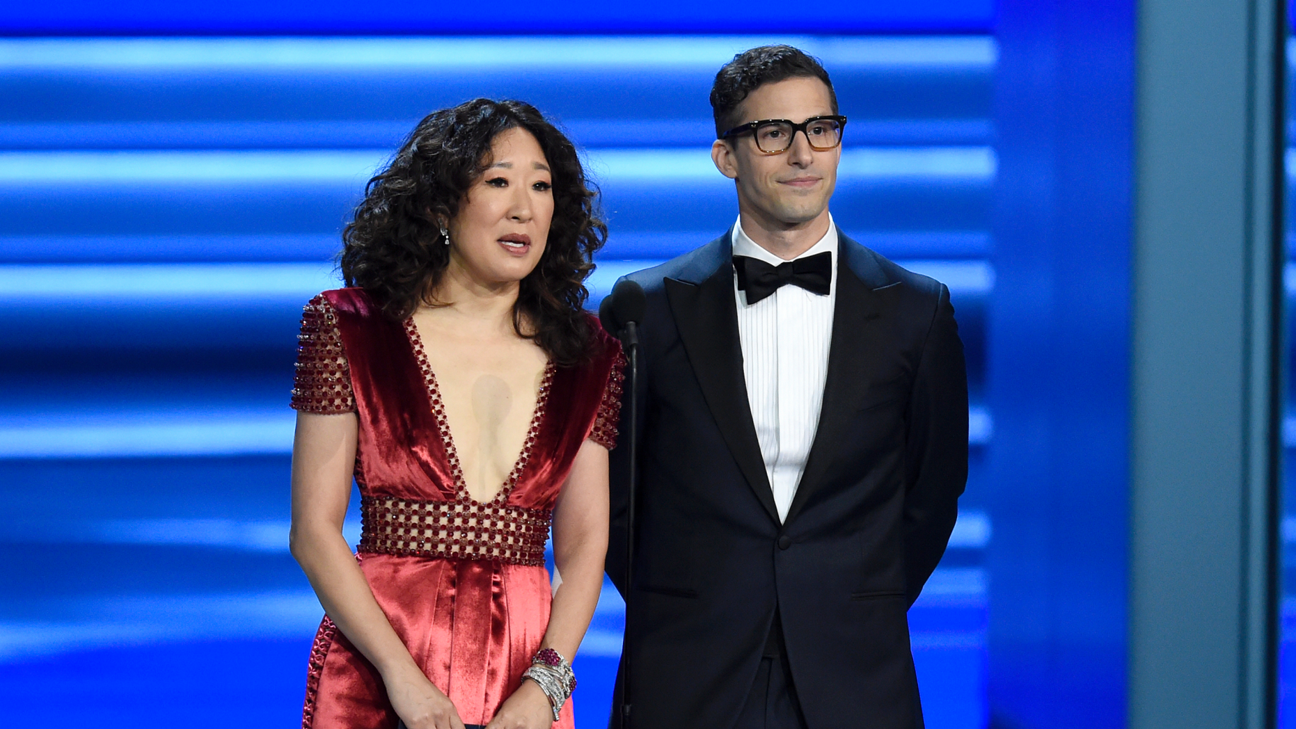 Sandra Oh, left, and Andy Samberg present an award at the 70th Primetime Emmy Awards in Los Angeles. Oh and Samberg will share host duties at next month's Golden Globe ceremony.