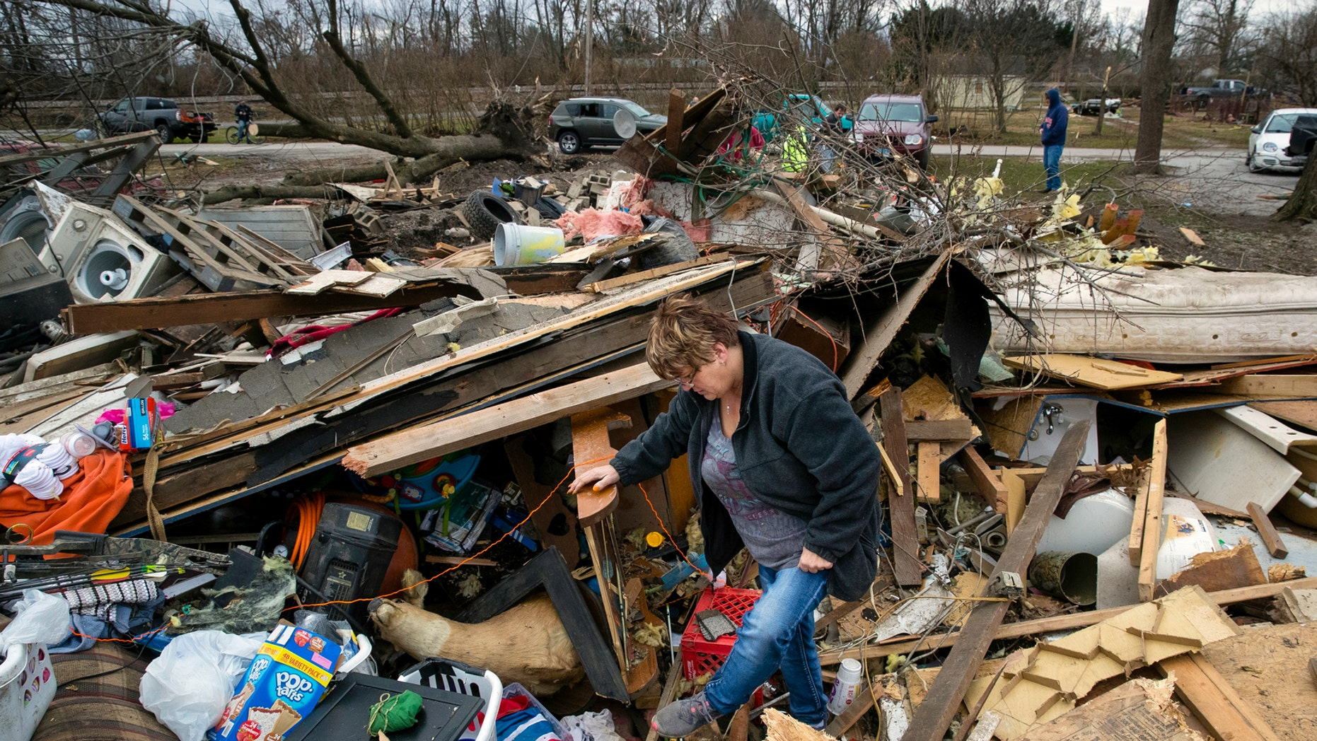 Joyce Morrissey sorts by a waste of her nephew Stephen Tirpak's residence in Taylorville, Ill., Sunday, Dec. 2, 2018. The National Weather Service says mixed tornadoes overwhelmed down in executive Illinois, deleterious dozens of structures and injuring mixed people. (Ted Schurter/The State Journal-Register around AP)