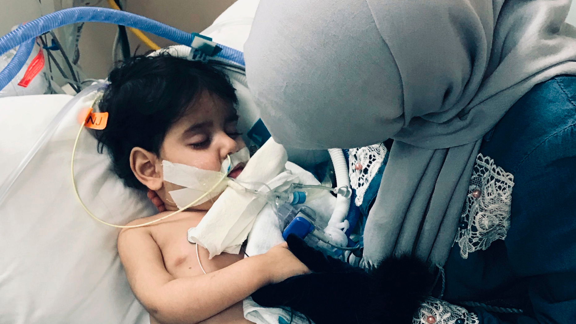 In this December 2018 photo released by the Council on American Islamic Relations, Sacramento Valley, Shaima Swileh, of Yemen, holds her dying 2-year old son Abdullah Hassan at UCSF Benioff Children's Hospital in Oakland, Calif. USA. The Council on American-Islamic Relations announced Friday, Dec. 28, 2018, that Abdullah died at the Oakland hospital, where his father Ali Hassan brought him in the fall to get treatment for a genetic brain disorder. Swileh, who is not an American citizen, sued the Trump administration to let her into the country to be with the ailing boy. (Council on American Islamic Relations, Sacramento Valley via AP)