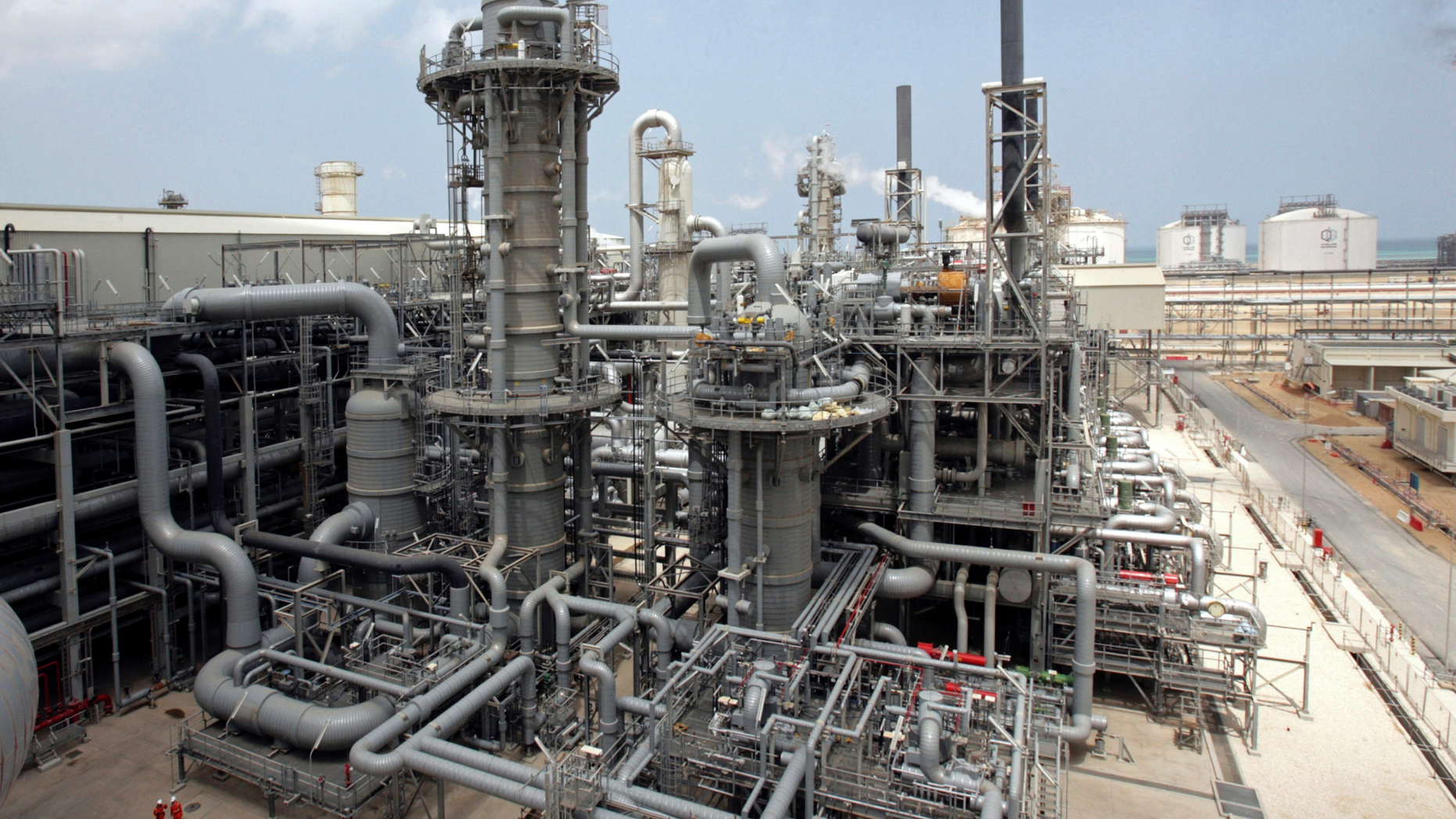 FILE - This April 4, 2009, file photo, shows a gas production facility at Ras Laffan, Qatar. The tiny, energy-rich Arab nation of Qatar announced on Monday, Dec. 3, 2018 it would withdraw from OPEC, mixing its aspirations to increase production outside of the cartel's constraints with the politics of slighting the Saudi-dominated group amid the kingdom's boycott of Doha. (AP Photos/Maneesh Bakshi, File)