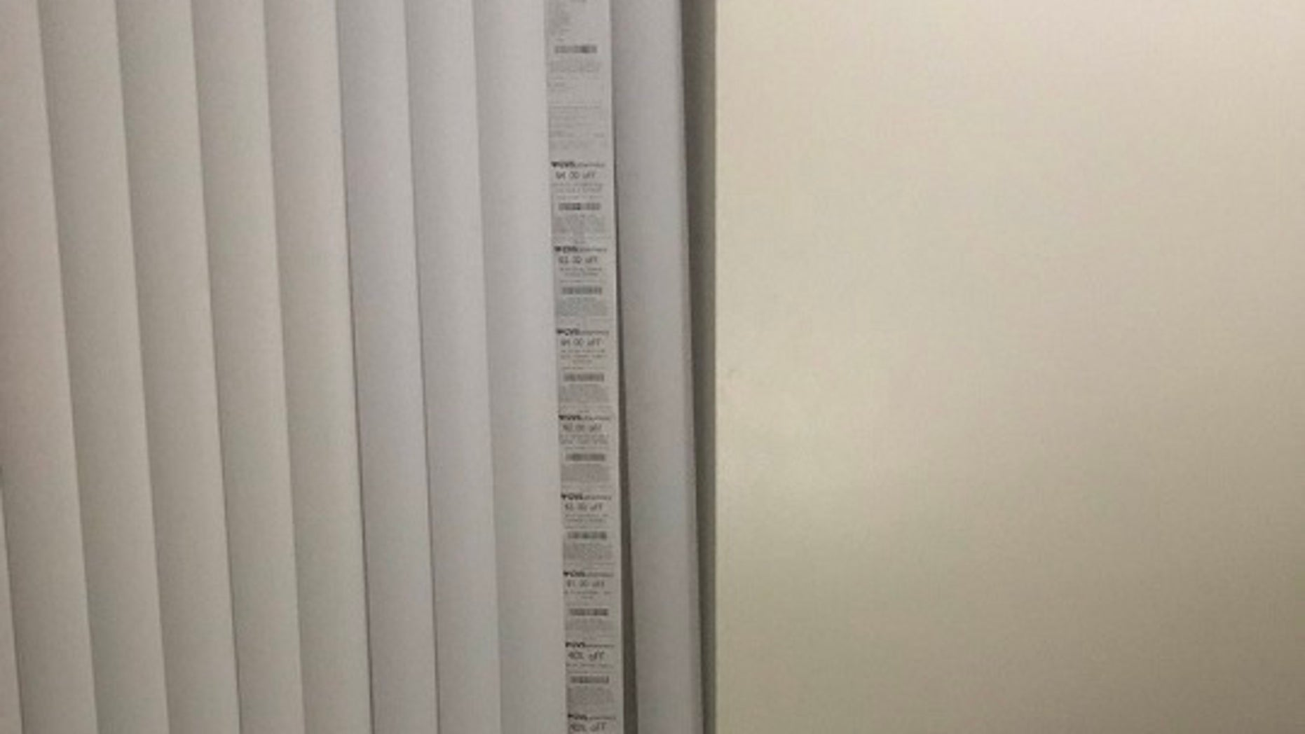 cvs customer uses lengthy store receipt as window