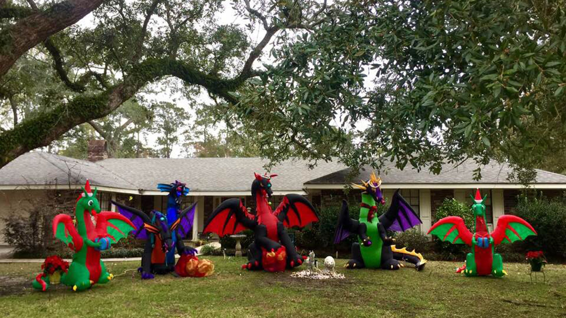 Fantasy author Diana Rowland added two more dragons to her Christmas ad after she received an anonymous note from a neighbor asking her to tear her down.