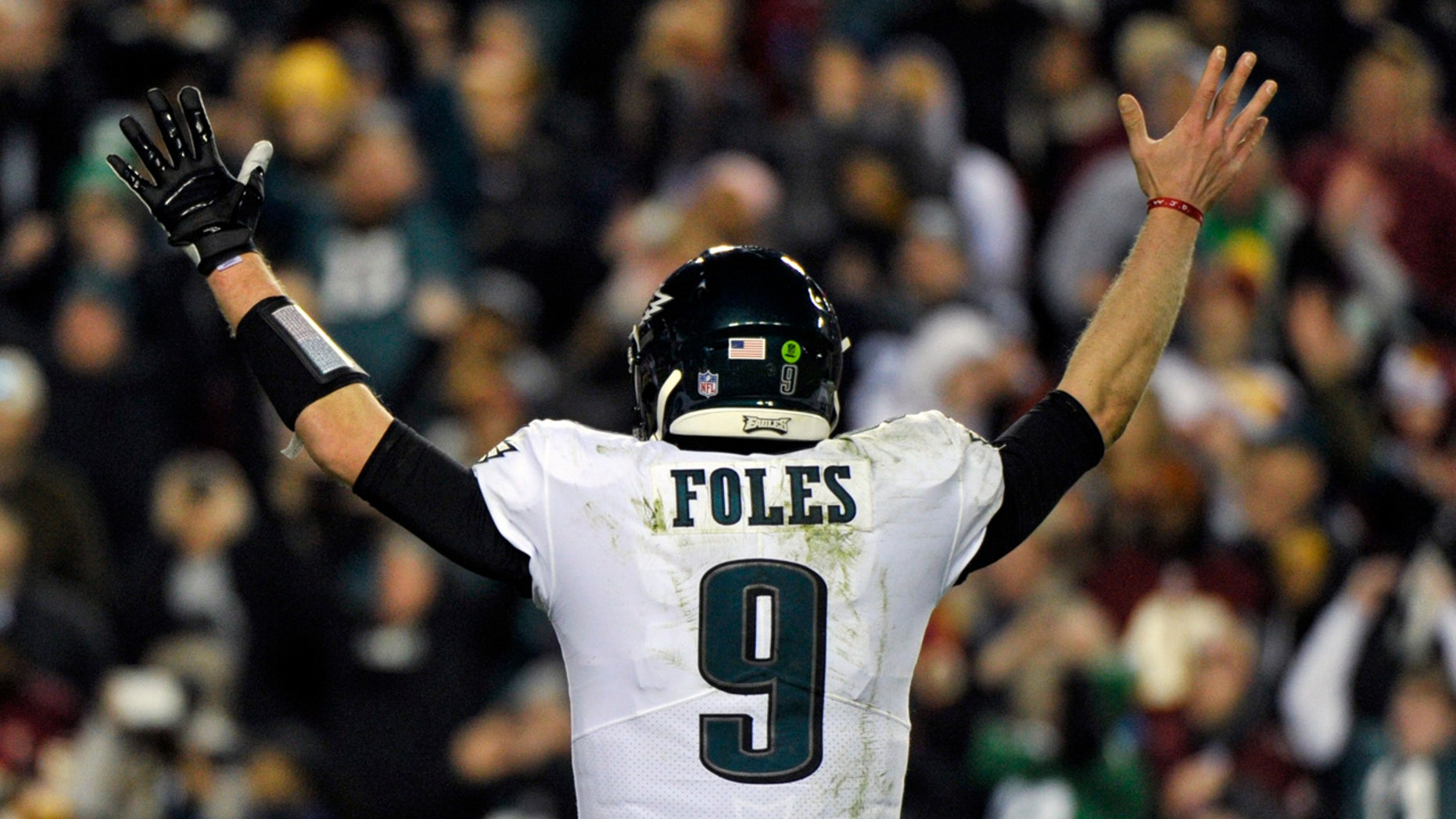 Philadelphia Eagles quarterback Nick Foles (9) reacts to wide receiver Nelson Agholor's touchdown during the second half of the NFL football game against the Washington Redskins, Sunday, Dec. 30, 2018 in Landover, Md. (AP Photo/Mark Tenally)