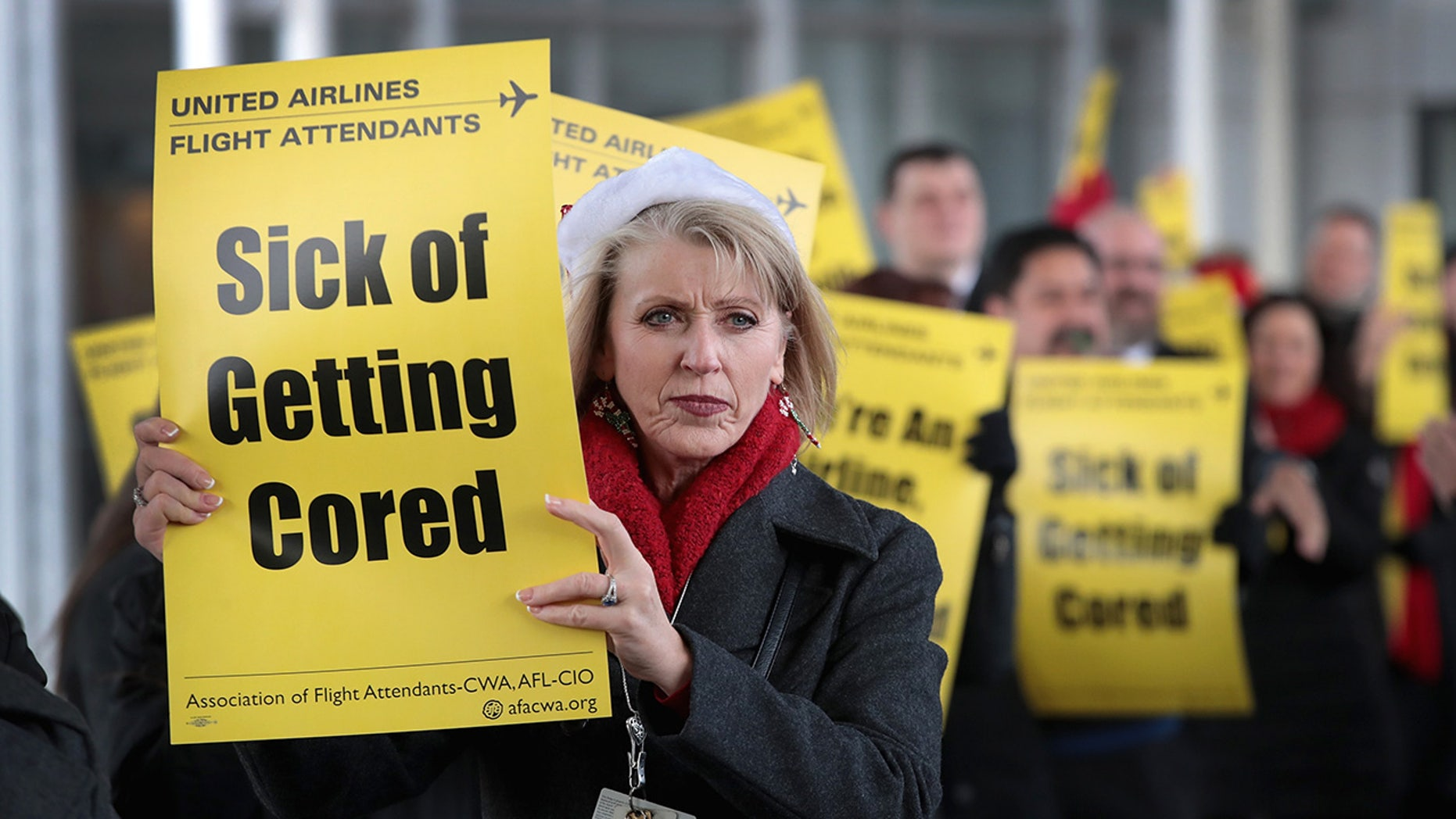Members of the Association of Flight Attendants-CWA protest United Airlines at O'Hare International Airport on Dec. 13, 2018 in Chicago. (Photo by Scott Olson/Getty Images)
