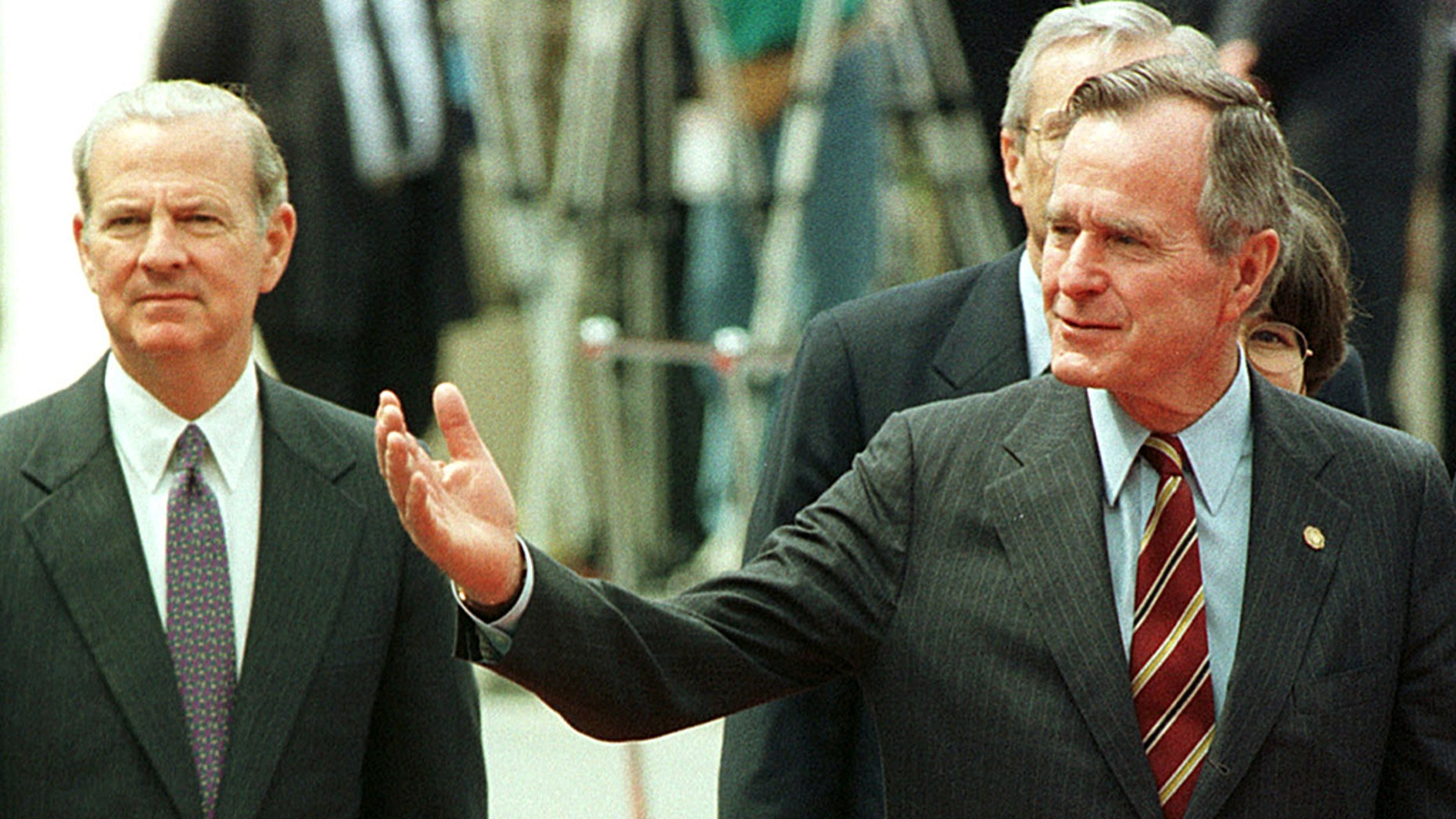Former U.S. President George H.W. Bush (R) with former U.S. Secretary of State James Baker during a welcome ceremony for the G-7 summit in Munich, June 1992.