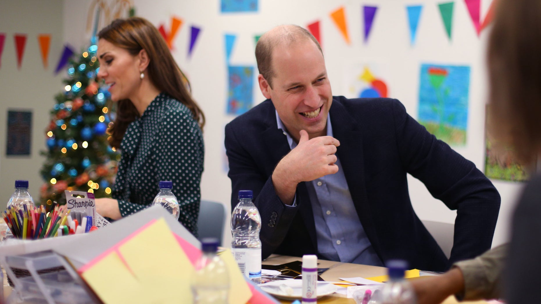 Catherine, Duchess of Cambridge and Prince William, Duke of Cambridge take part in an arts and craft session with clients during their visit to the homeless charity The Passage on December 11, 2018 in London, England.