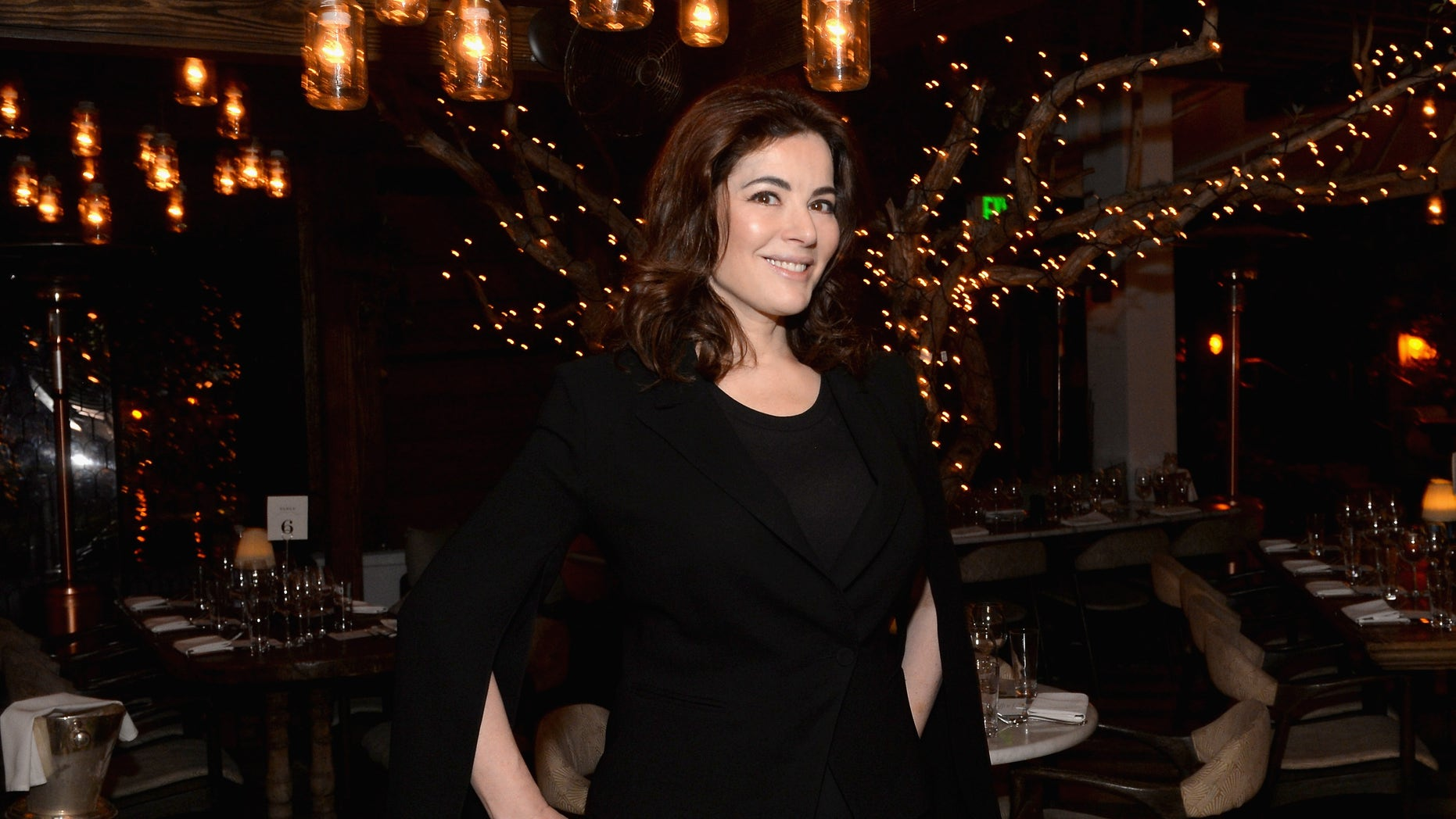 Nigella Lawson revealed she's had to tell U.S. television stations to stop airbrushing her stomach.