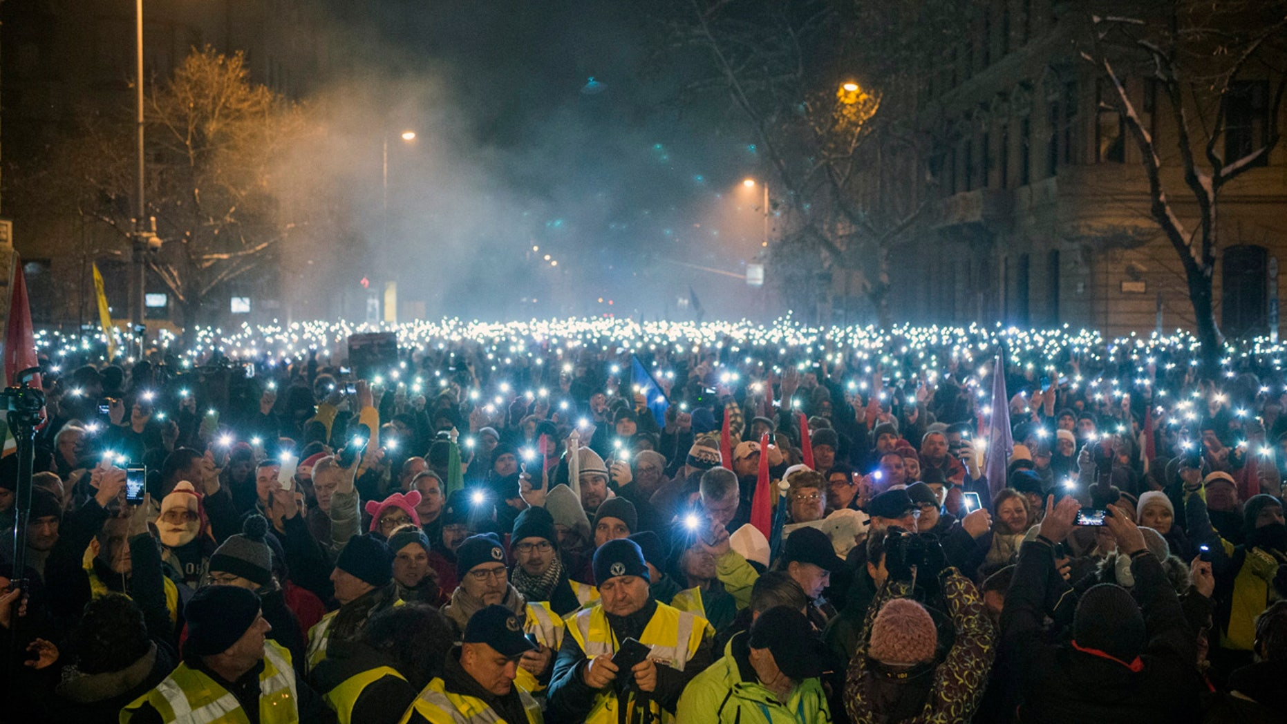 Anti-government demonstrators lighting up their phones during their protest in downtown Budapest on Sunday. (Zoltan Balogh/MTI via AP)