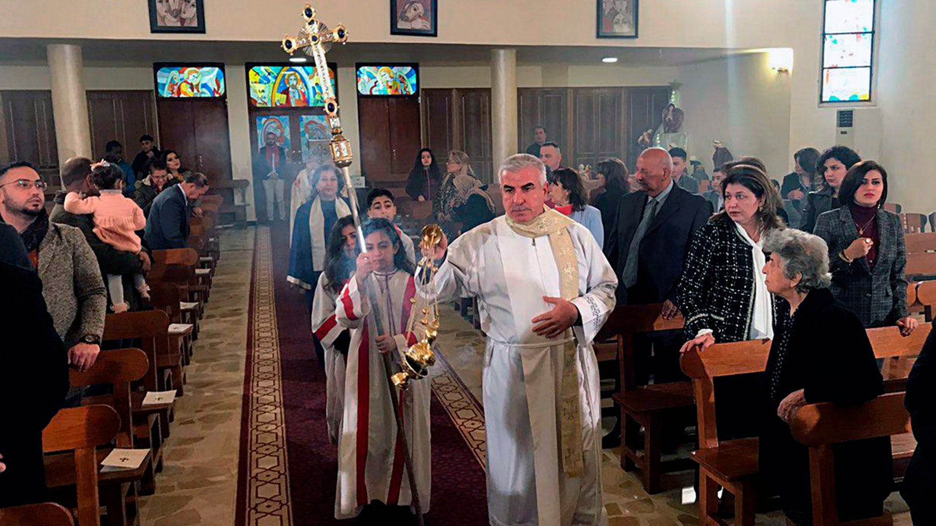 Iraqis attend Christmas Mass at Mar Youssif Chaldean Church, in Baghdad, Iraq, Tuesday, Dec. 25, 2018. Although the number of Christians has dropped in Iraq, Christmas, a national holiday, is very popular in the capital. (AP Photo/Ali Abdul Hassan)