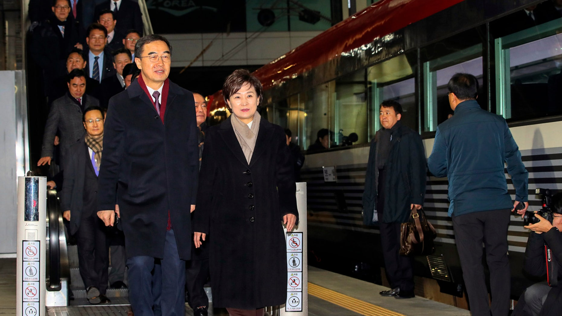 South Korean Unification Minister Cho Myoung-gyon, bottom left, and officials arrive to board a train to leave for North Korea at the Seoul Railway Station in Seoul, South Korea, Wednesday, Dec. 26, 2018. (Jin Sung-chul/Yonhap via AP)