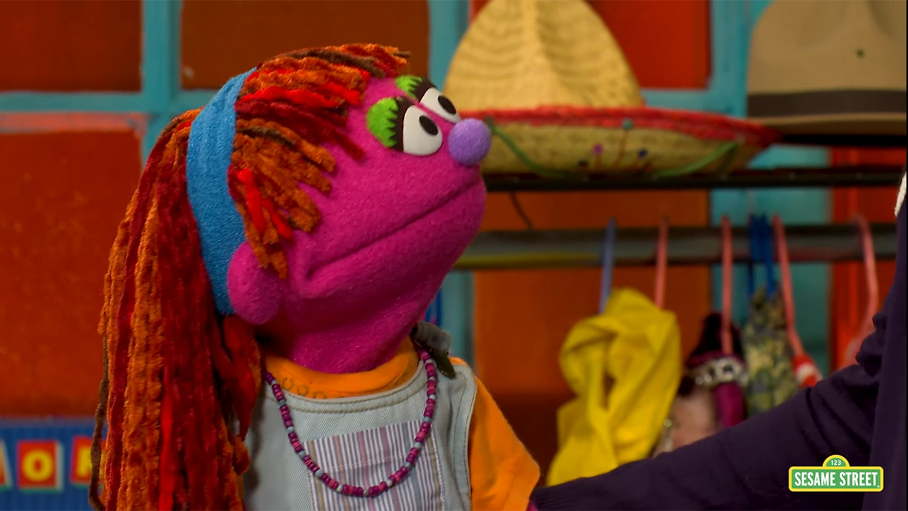 "Lily discusses homelessness on ""Sesame Street."""
