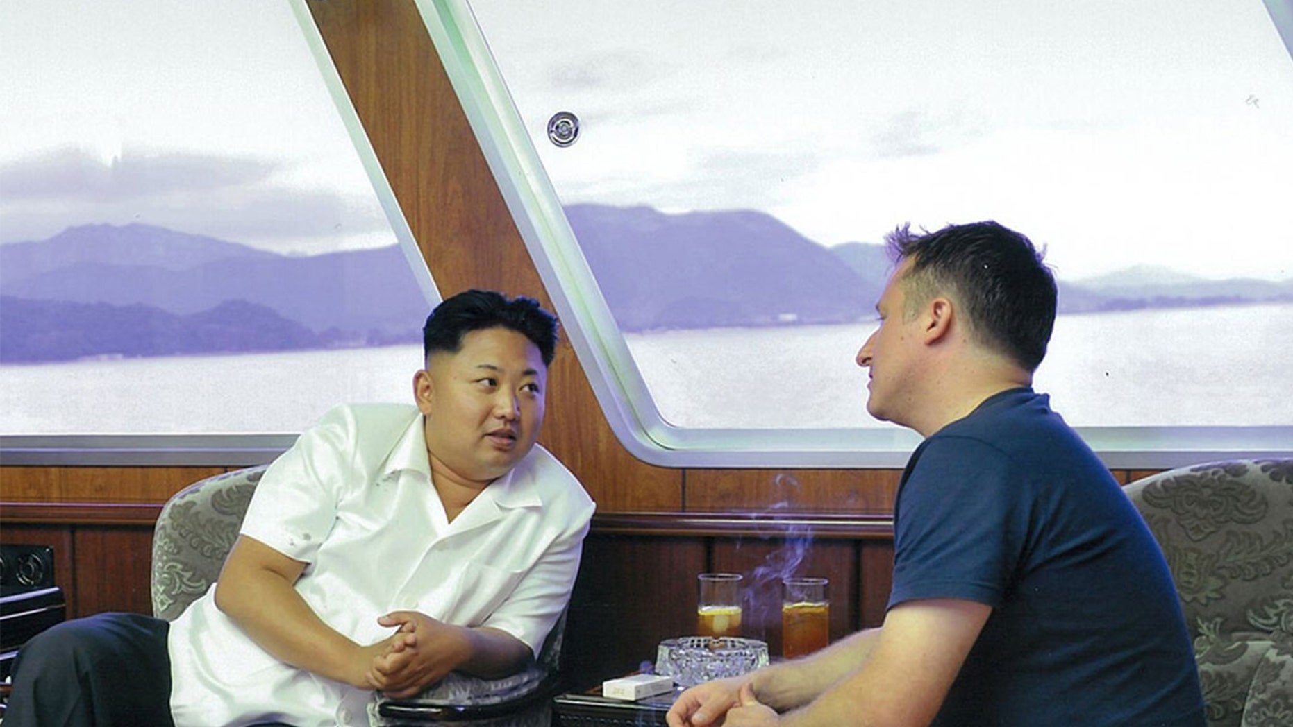 Kim Jong Un shares cocktails with Michael Spavor of the Paektu Cultural Exchange on board the North Korean leader's private yacht in Wonsan North Korea in 2013