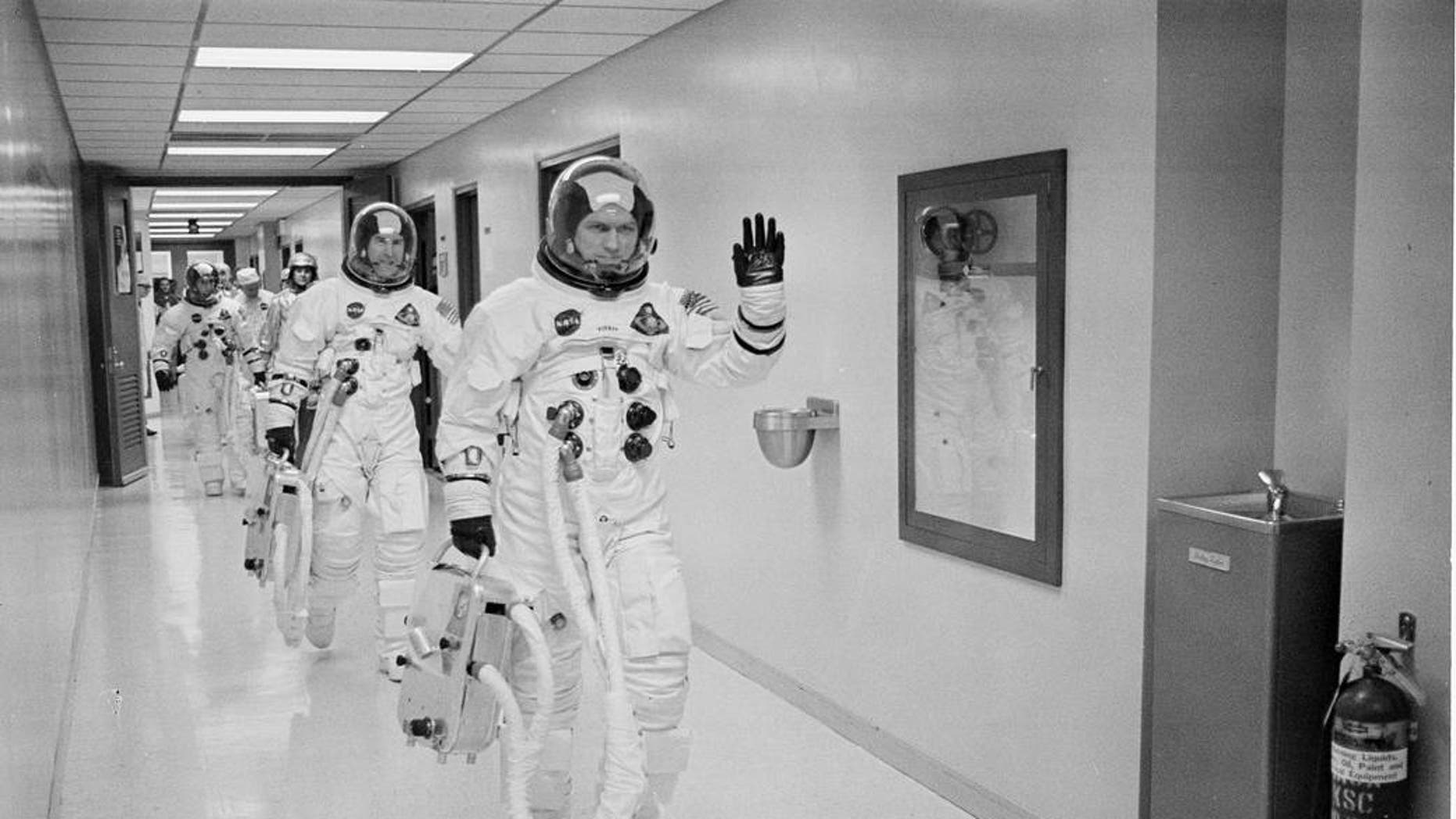 Apollo 8 Commander Colonel Frank Borman leads the way as he, Command Module Pilot Captain Jim Lovell, and Lunar Module Pilot Major Bill Anders head to the launch pad for humanity's maiden voyage around the moon and its first aboard the Saturn V vehicle.