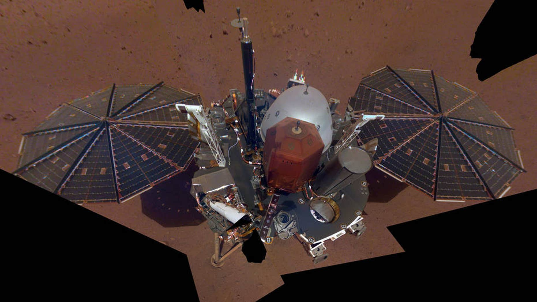"NASA InSight Lander has taken its first selfie on Mars. The ""mosaic"" is pieced together from 11 images. The selfie was taken on Dec. 6, 2018. (NASA/JPL-Caltech)"