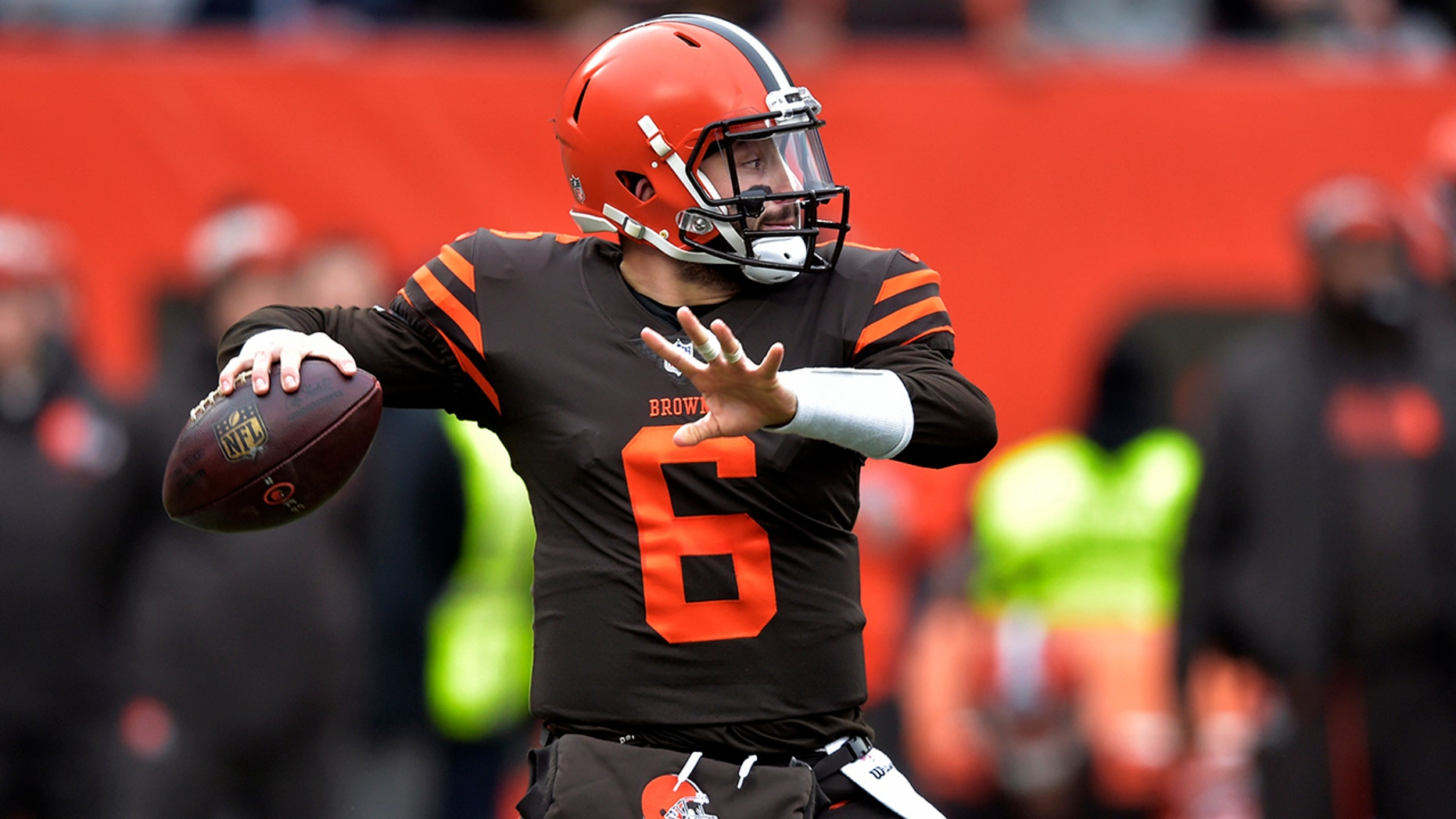 Cleveland Browns quarterback Baker Mayfield throws during the first half of an NFL football game against the Cincinnati Bengals on Sunday, Dec. 23, 2018, in Cleveland.