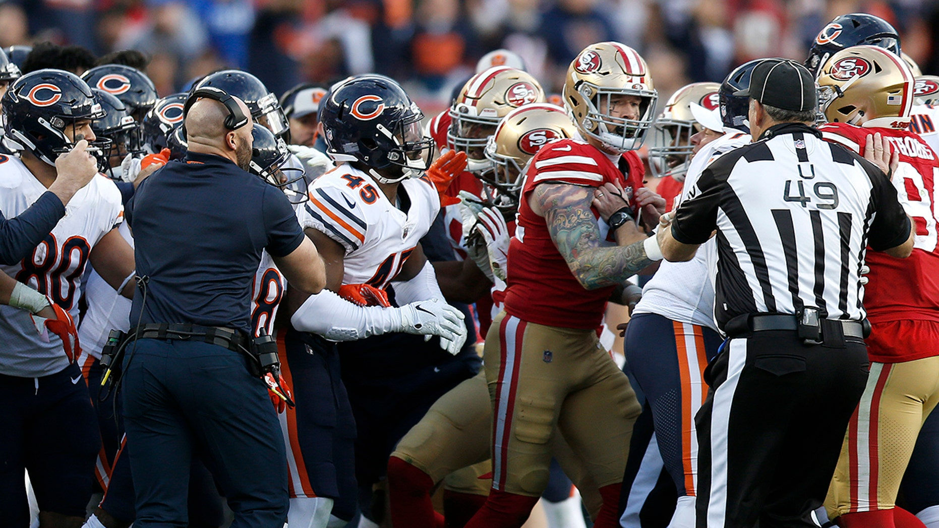 Coaches and officials try to separate Chicago Bears and San Francisco 49ers players during the second half of an NFL football game in Santa Clara, Calif., Sunday, Dec. 23, 2018.