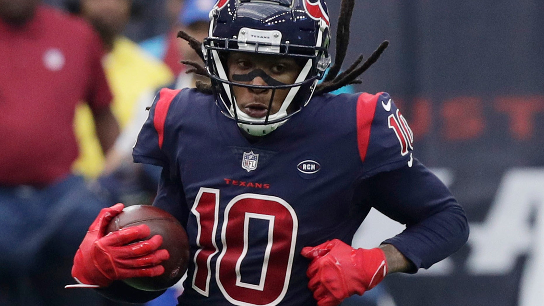 Houston Texans wide receiver DeAndre Hopkins (10) is defended by Cleveland Browns strong safety Damarious Randall (23) after making a catch during the first half of an NFL football game.