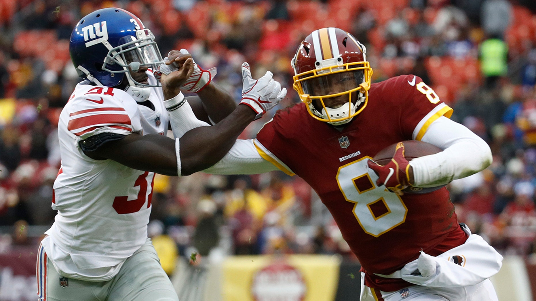 Washington Redskins quarterback Josh Johnson (8) tries to get away from New York Giants defensive back Michael Thomas (31) during the second half of an NFL football game Sunday, Dec. 9, 2018, in Landover, Md.