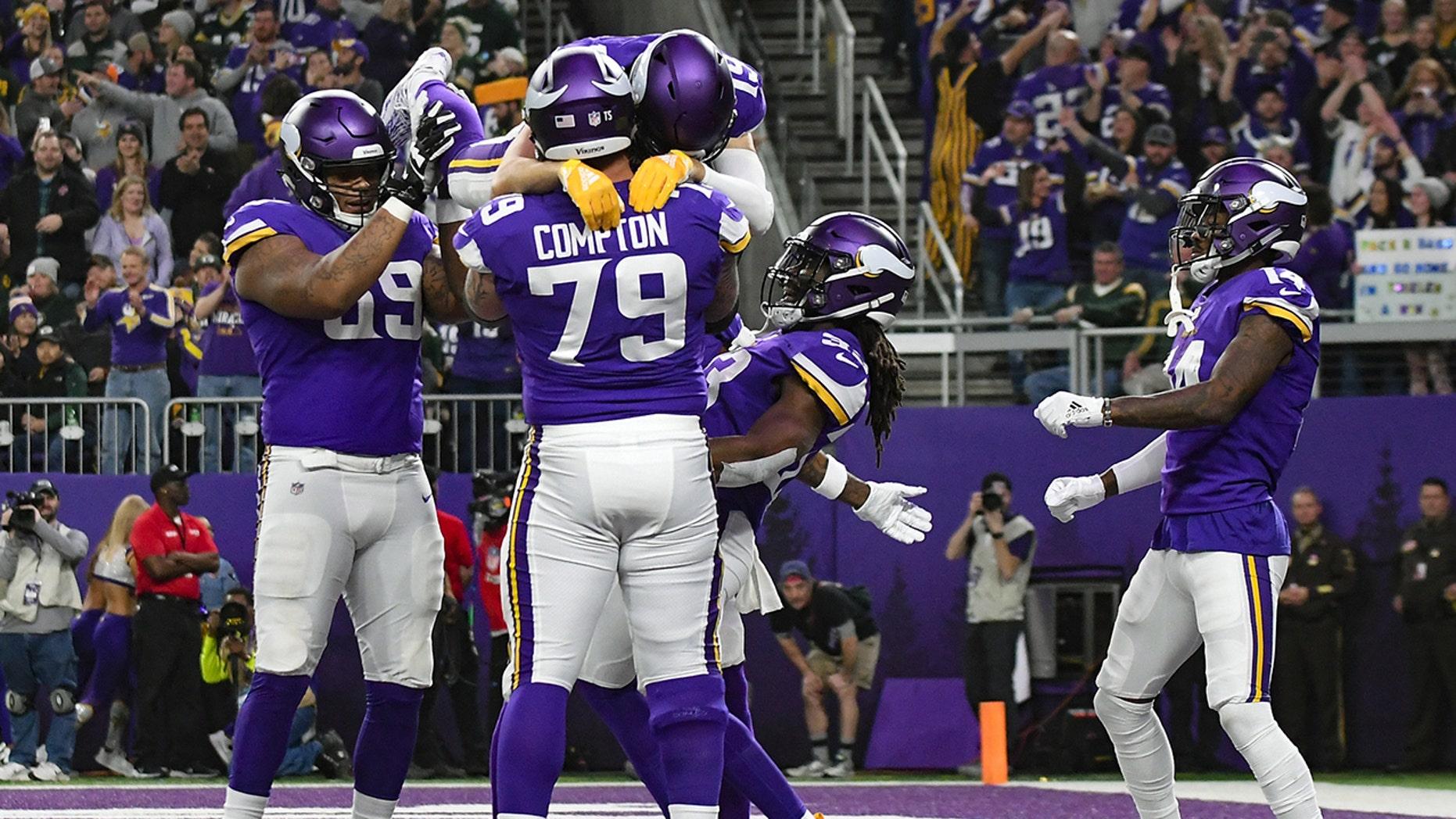 The Vikings celebrate a touchdown at U.S. Bank Stadium.