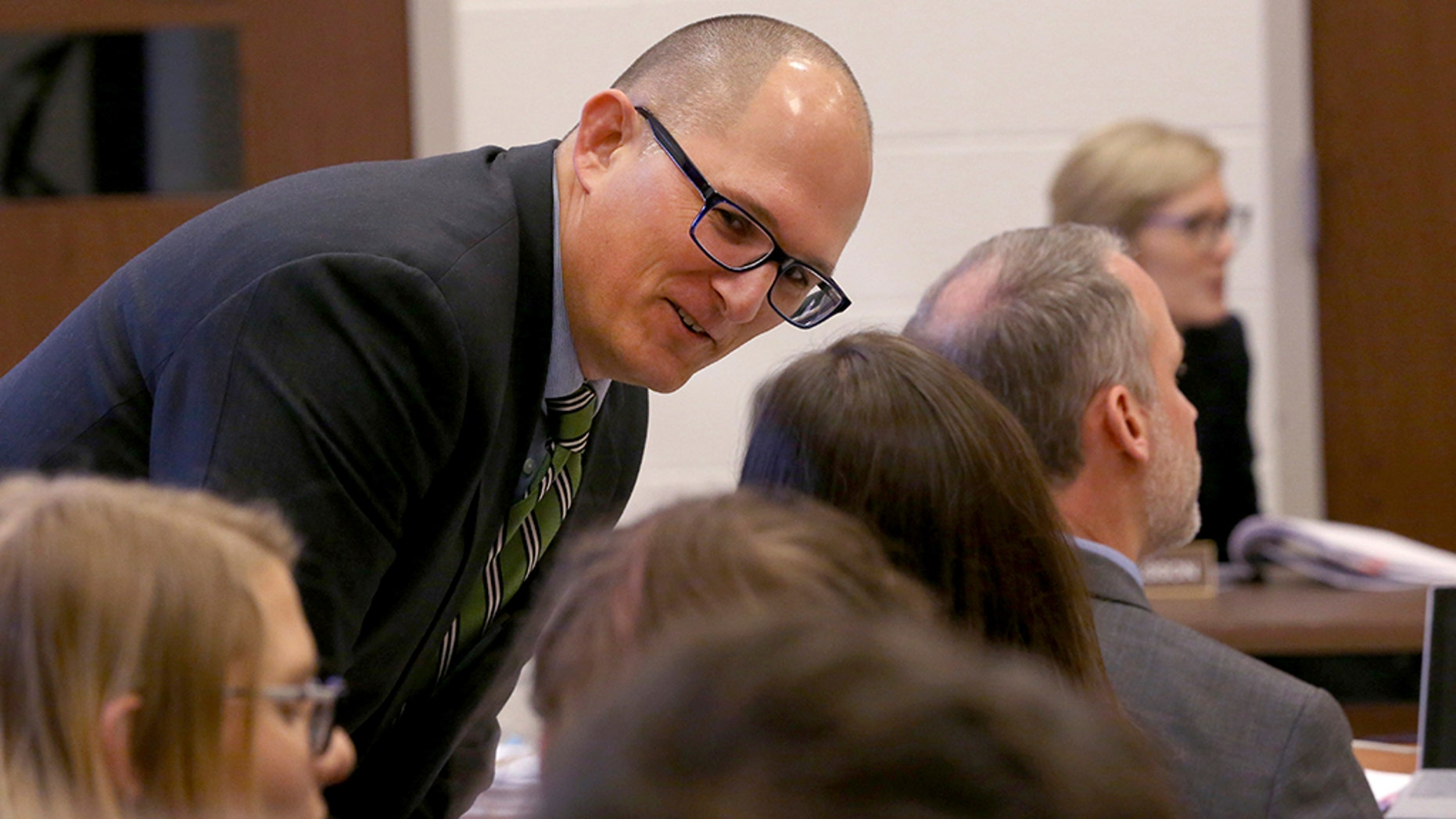 High school teacher Peter Vlaming chats at a West Point School Board hearing in West Point, Va., Dec. 6, 2018. The board voted unanimously to dismiss Vlaming.