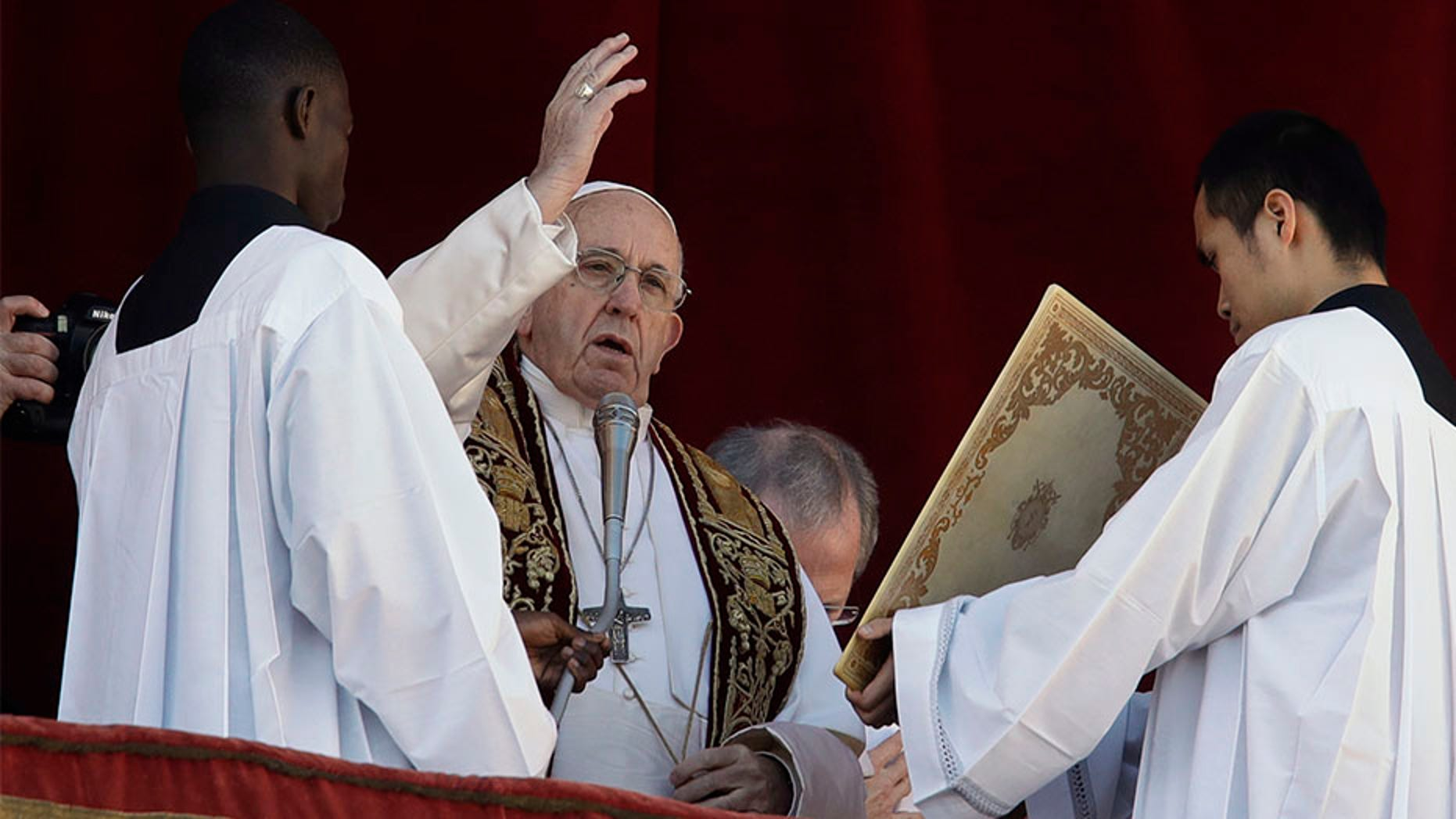 Pope Francis delivers the Christmas' day blessing from the main balcony of St. Peter's Basilica at the Vatican.