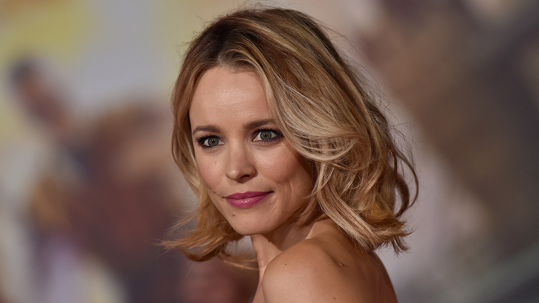 Rachel McAdams poses in Versace and a breast pump