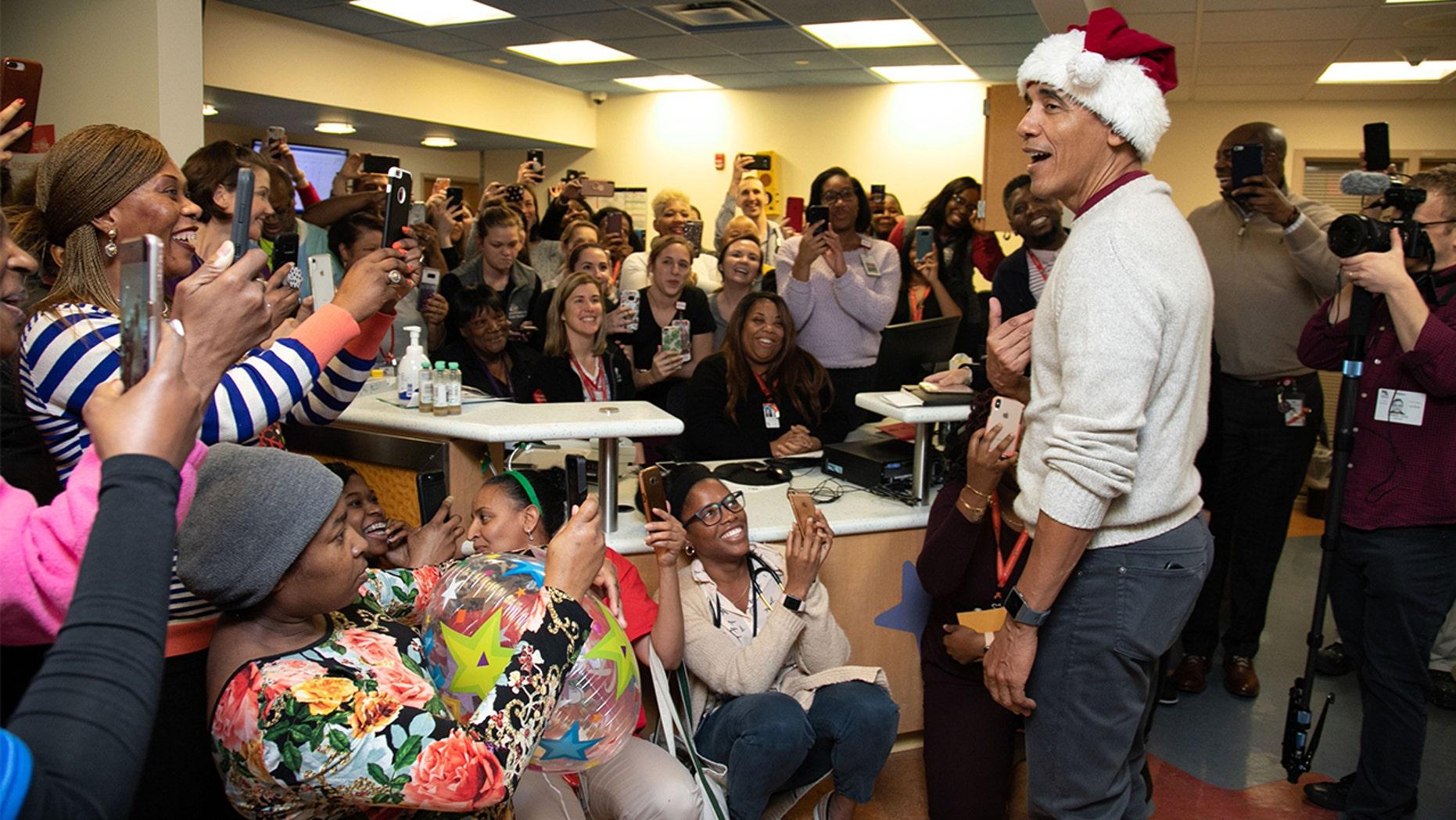 Barack Obama delivers presents to kids at children's hospital