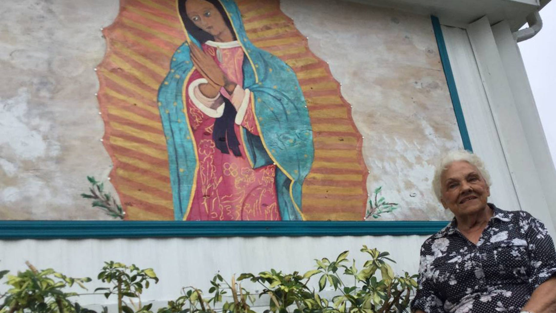 Millie Francis, 85, says she was inspired to paint a picture of the Virgin Mary on a piece of plywood that replaced a window she wanted removed from her mobile home in Bradenton, Florida.