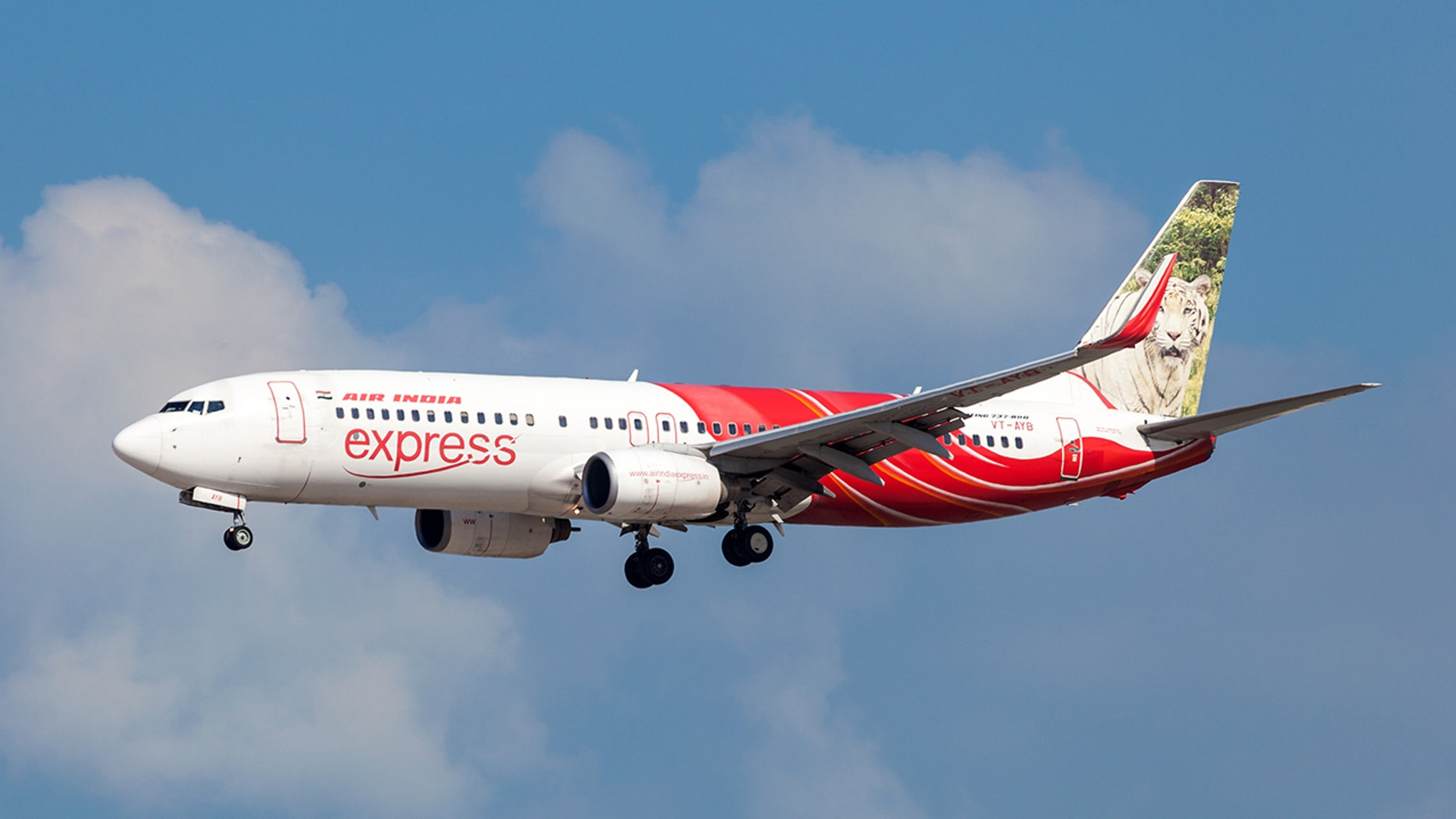 An Air India Express passenger stripped naked and started walking down the aisle, according to reports.
