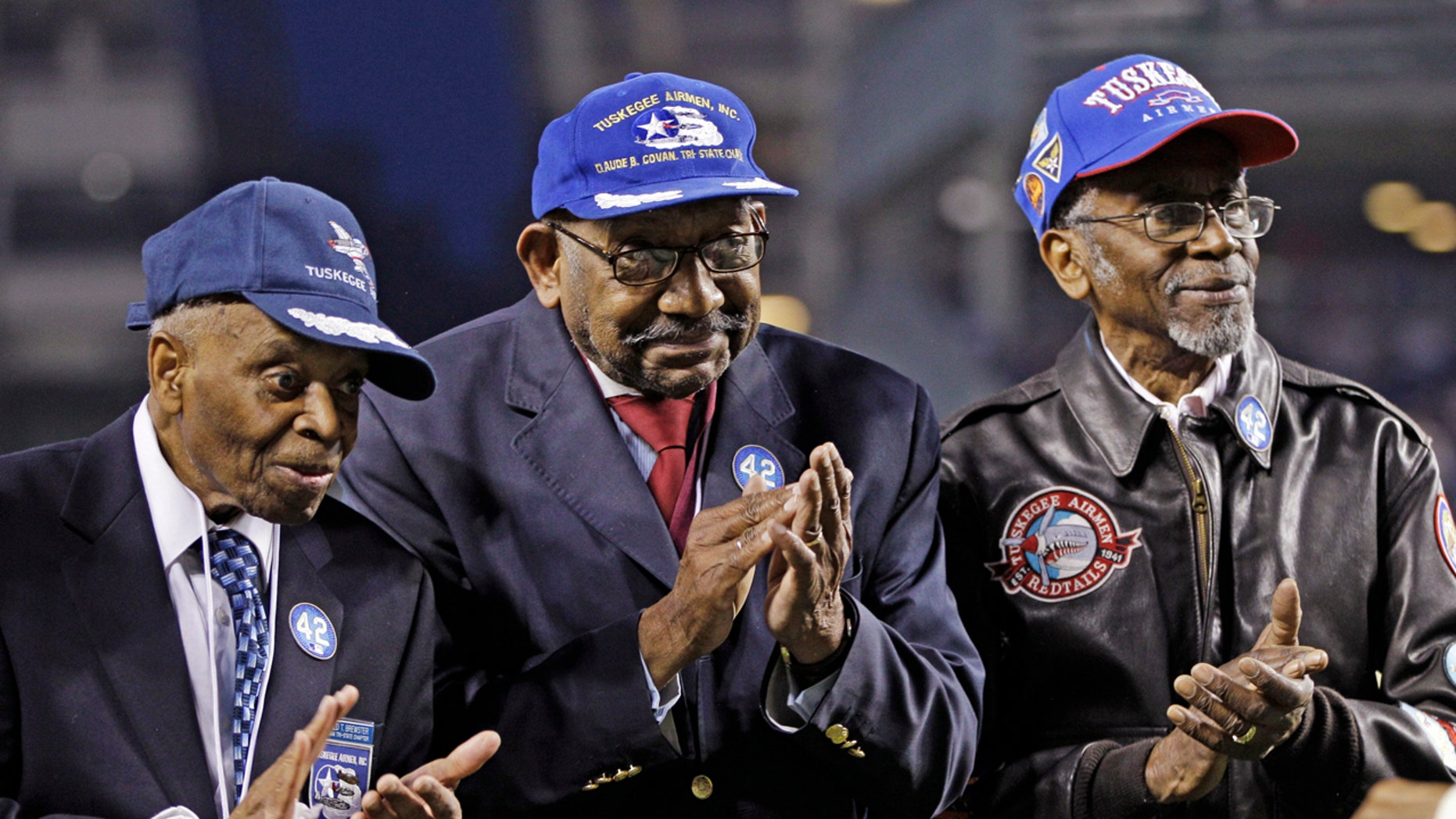Tuskegee Airman Wilfred DeFour (far right) died from apparent natural causes at the age of 100. (AP Photo/Kathy Willens, File)